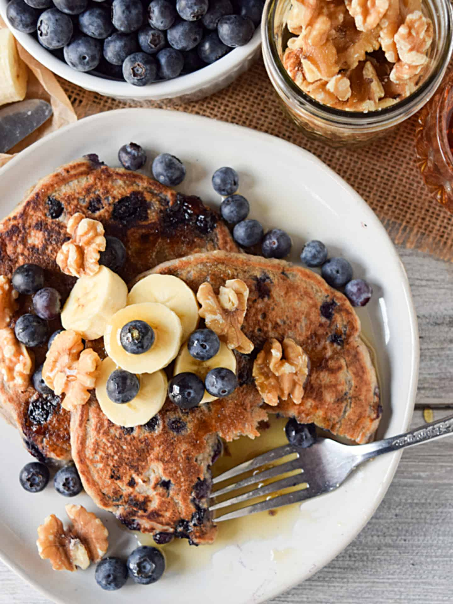 Vegan blueberry pancakes with fork.