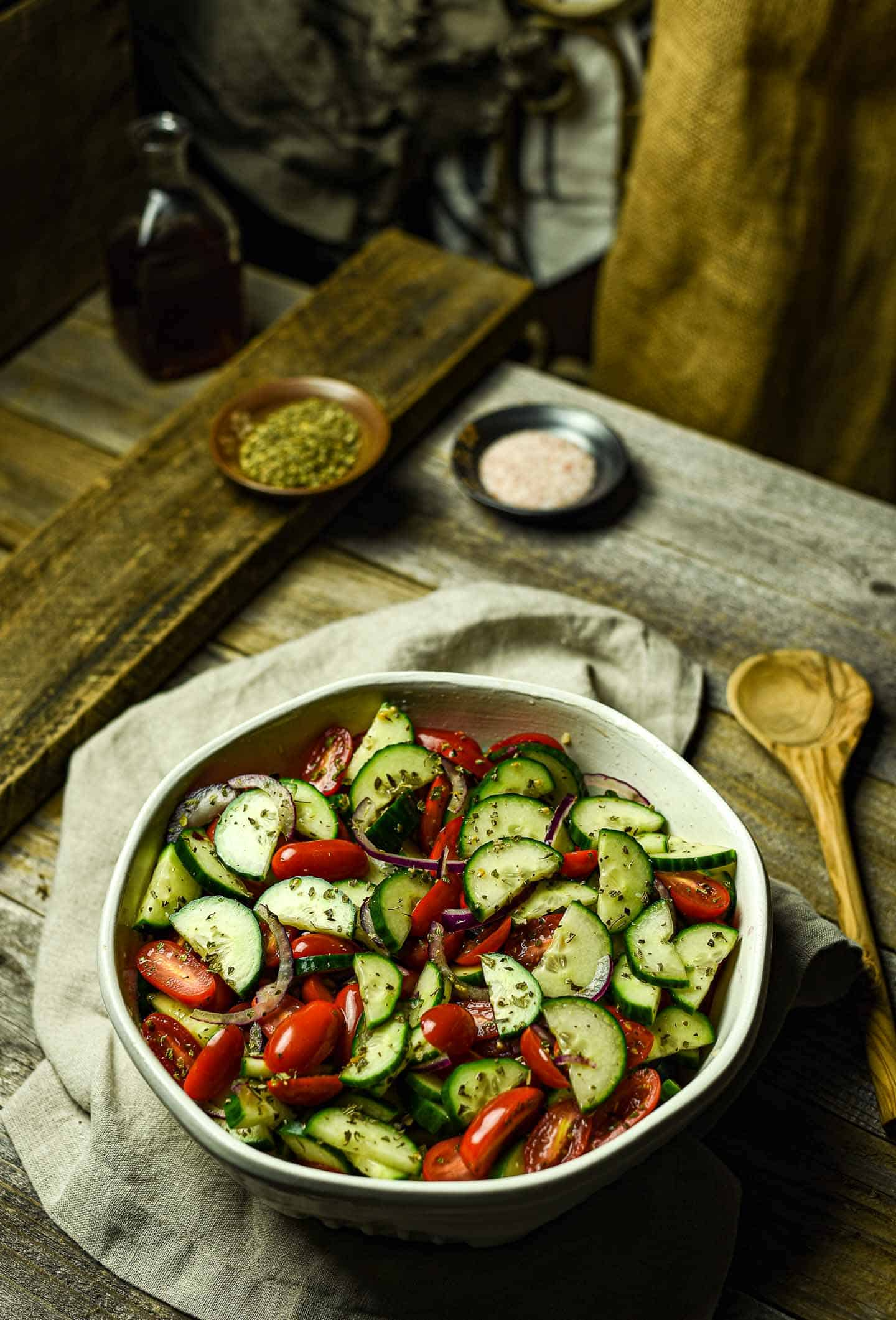Cucumber tomato salad in large bowl.