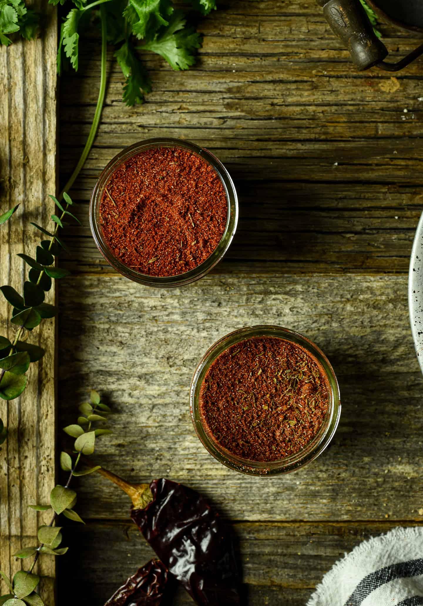 Blackened seasoning in two small jars.