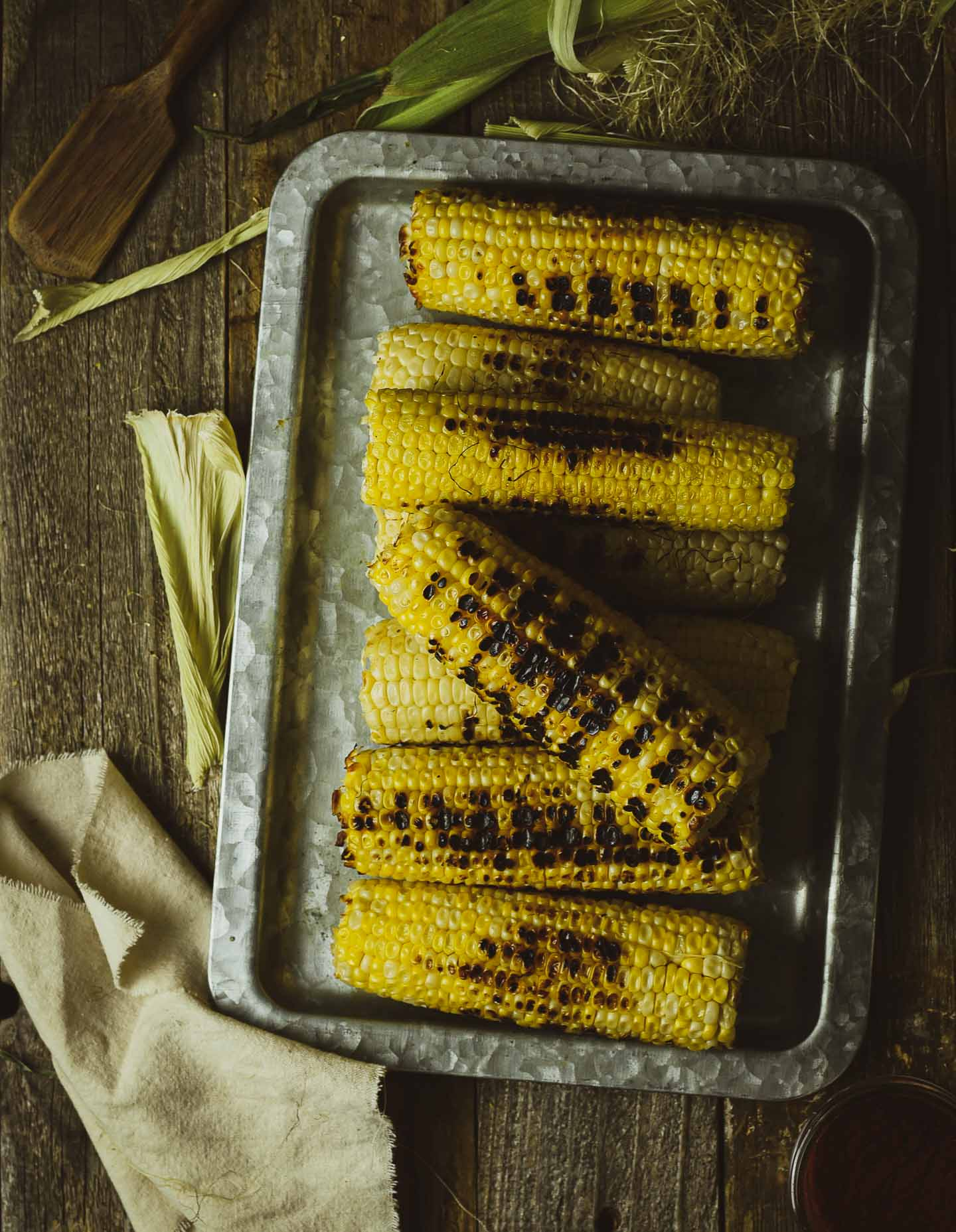 grilled corn on tray