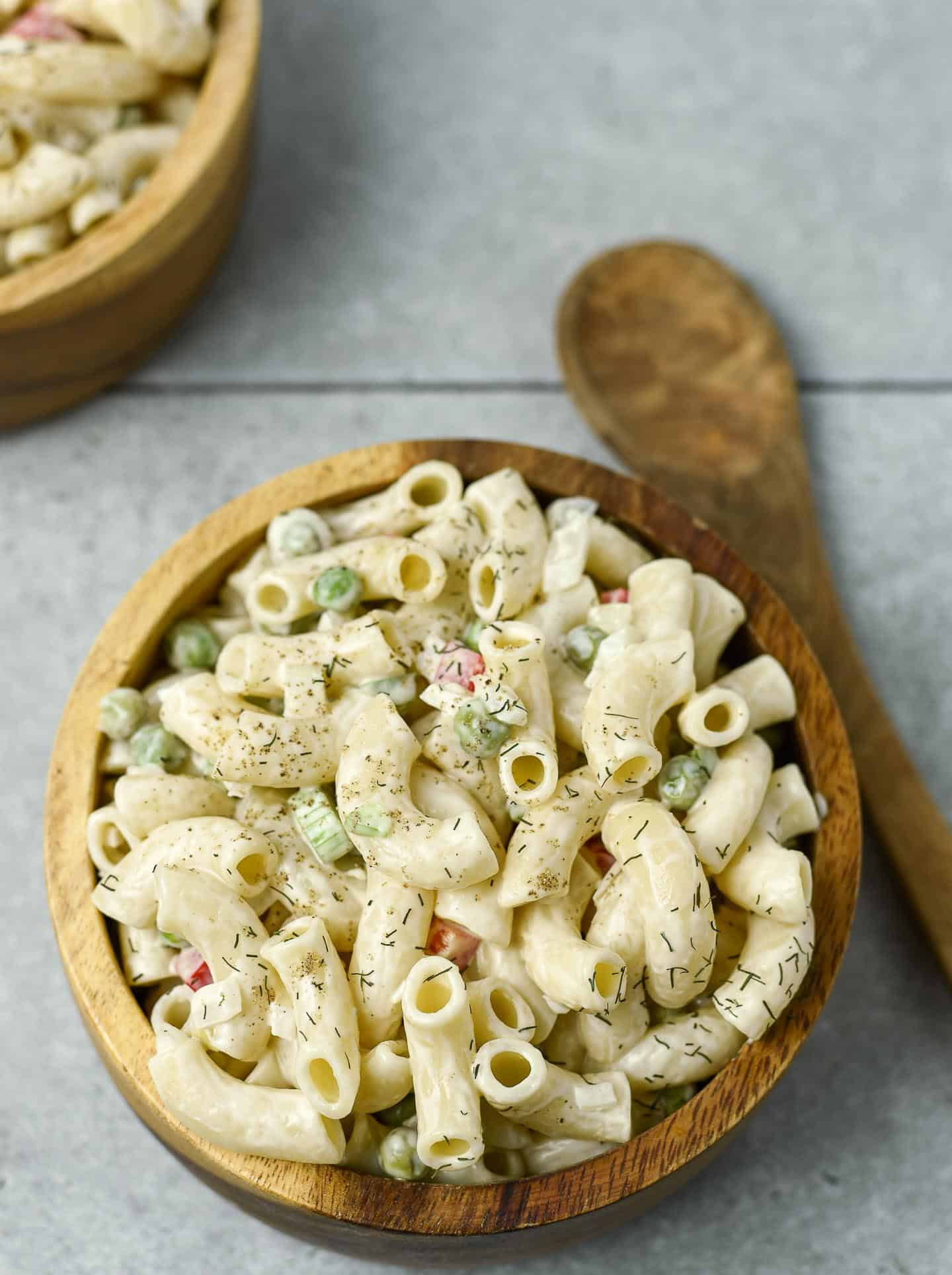 Macaroni salad in wooden bowl.