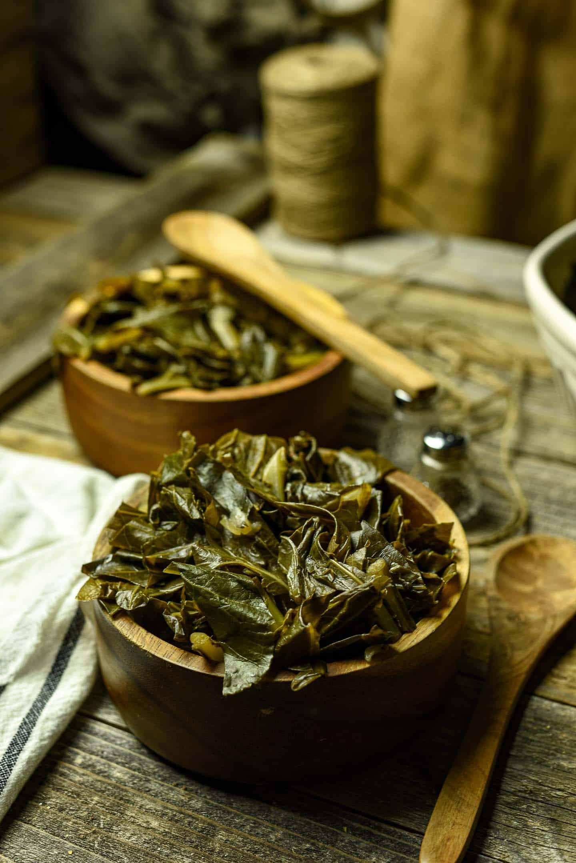 Collard greens in wooden bowls.
