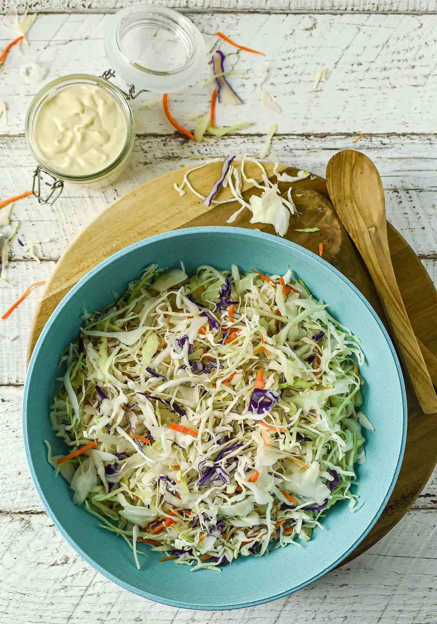 Easy Vegan Coleslaw is creamy, delicious, and so easy to make. Made in one bowl with 5 ingredients, it's perfect for BBQs, picnics, and summer potlucks! Oil-free, gluten-free, and healthy.
