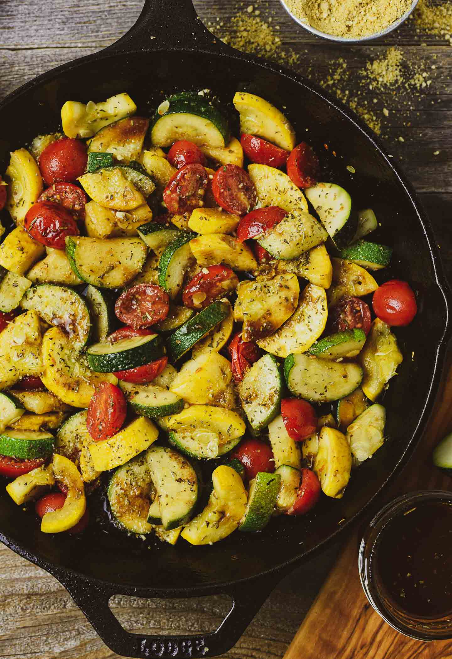 This Vegan Summer Squash Sauté is healthy, delicious, and so easy to make. It's made with yellow squash, zucchini, cherry Tomatoes, and vegan parmesan in one skillet. And, it's completely oil-free.