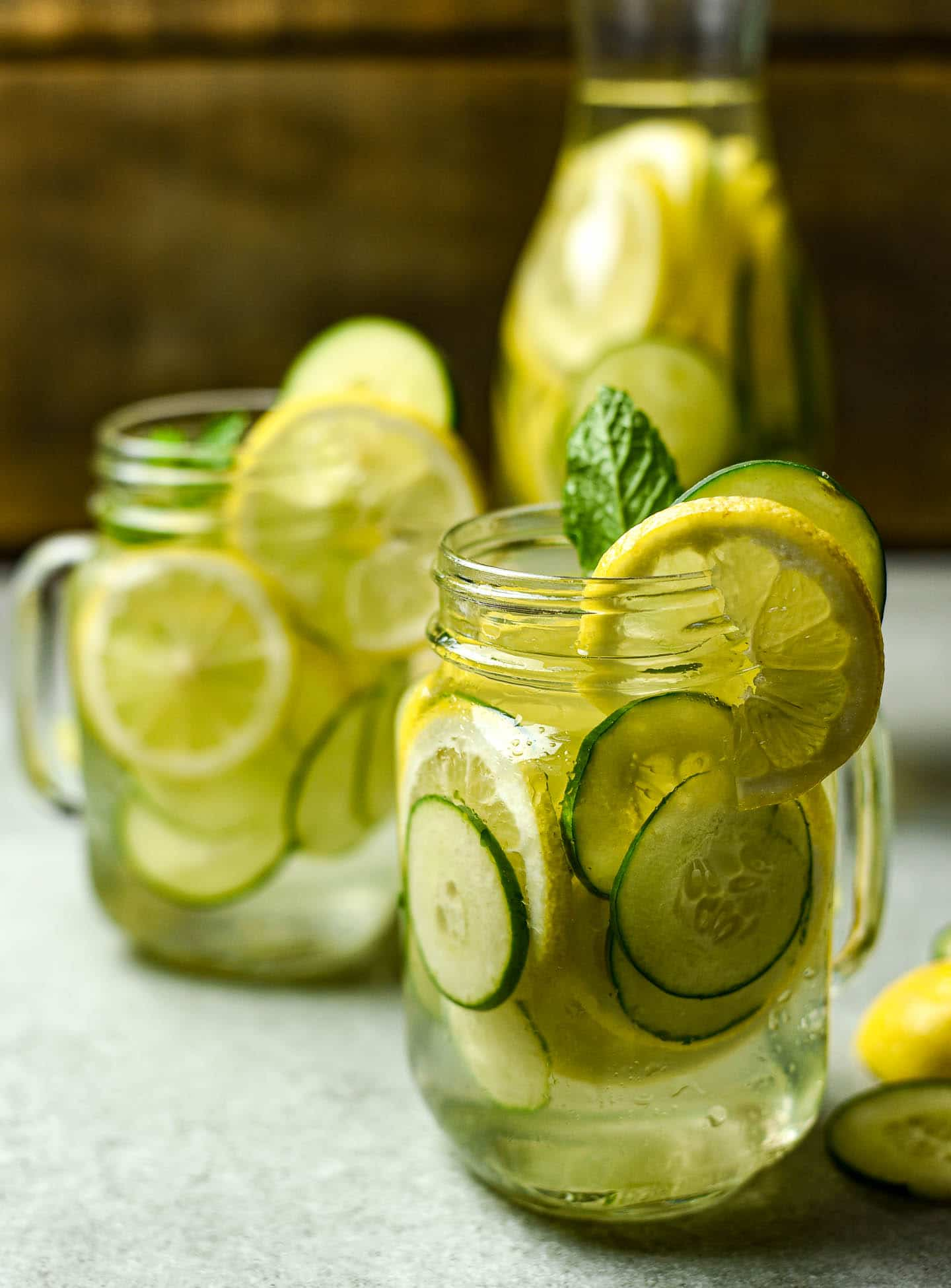 Deliciously refreshing lemon cucumber water made with only lemons, cucumbers, and water. Garnish with fresh mint or berries of your choice. Perfect day or night.