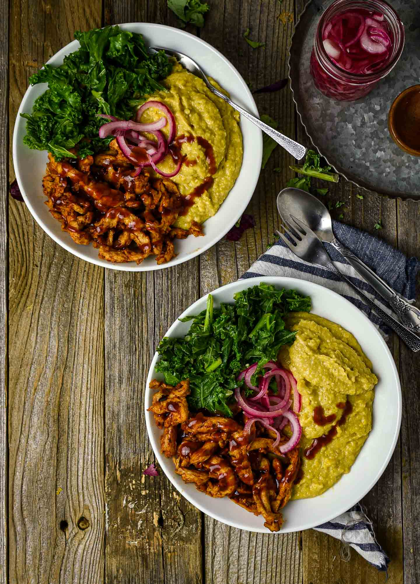 Vegan Grits Bowl with BBQ Soy Curls and Sauteed Kale is the definition of comfort food. A delicious and healthy plant-based breakfast bowl featuring creamy cheesy grits, hearty bbq soy curls, and greens.