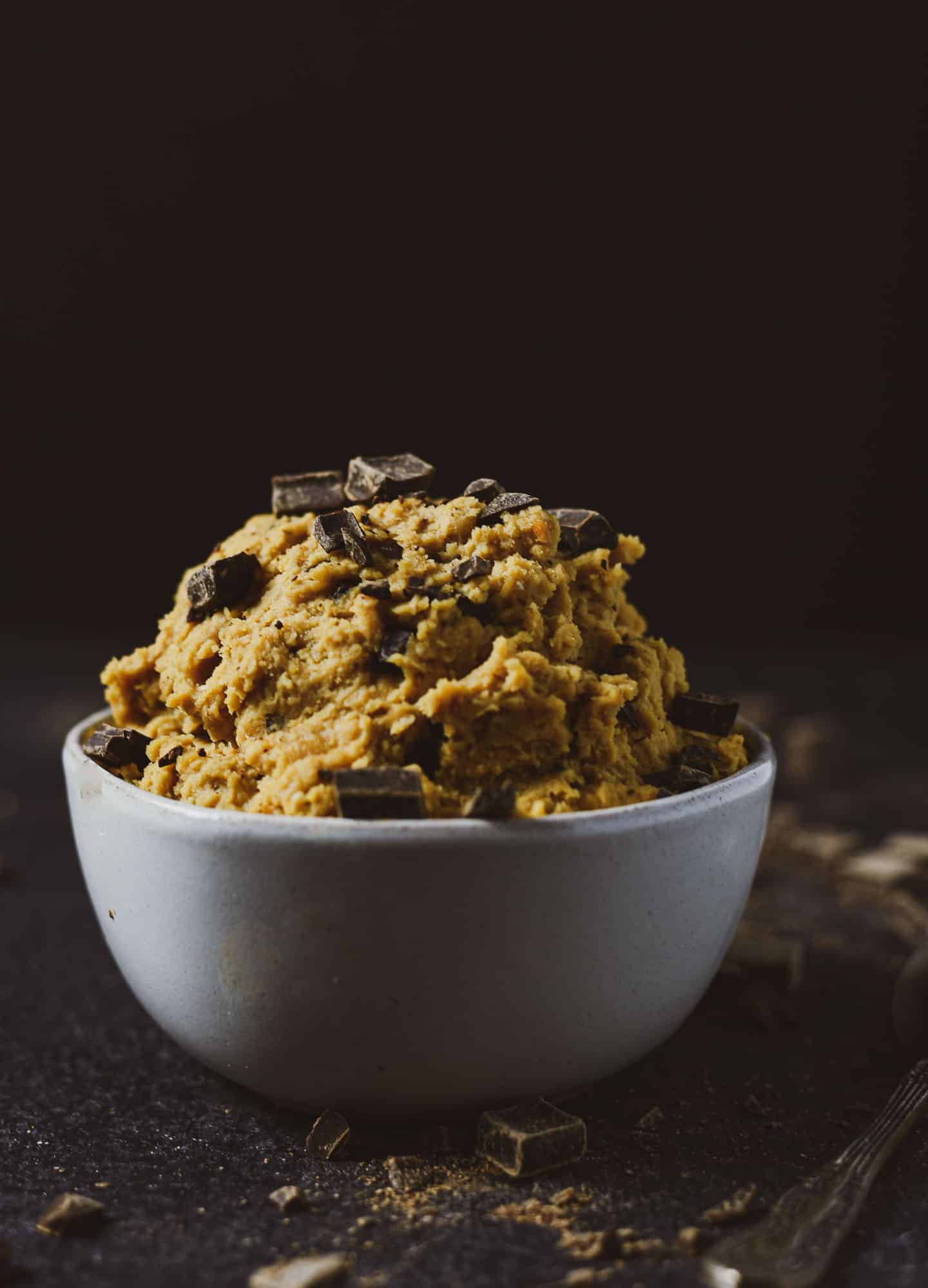 This Vegan Edible Cookie Dough is healthy, delicious, and so easy to make. All you need are a few simple ingredients to make this incredibly decadent dessert. It's naturally gluten-free, dairy-free, and ready in 5 minutes.