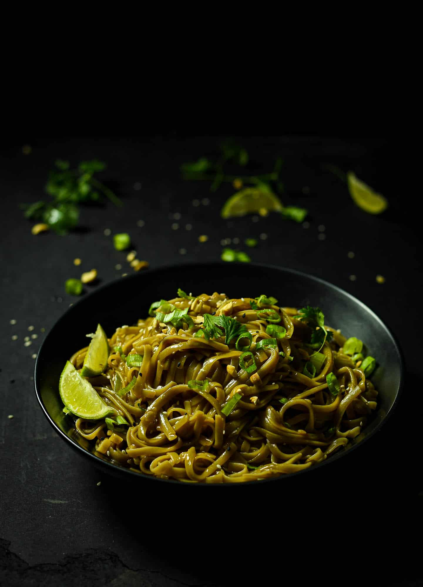 This Spicy Asian Noodle Bowl is so easy to make and uses very simple ingredients already in your pantry. It's fast, delicious, and ready in as little as 5 MINUTES! Optional toppings included peanuts, cilantro, green onions, sesame, and a dash of lime.