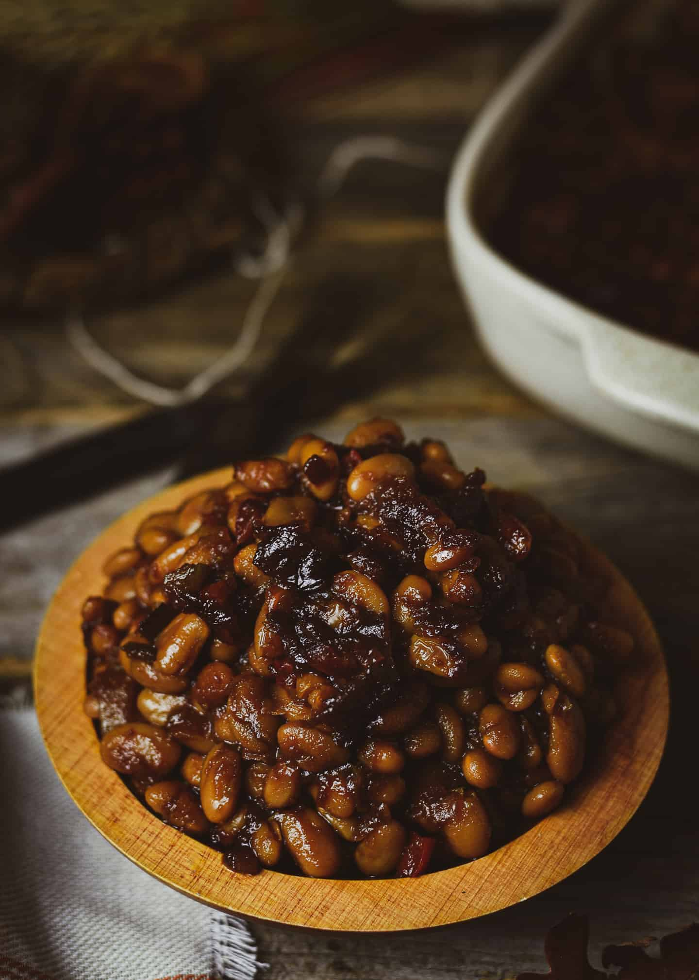 Baked beans in wooden bowl.