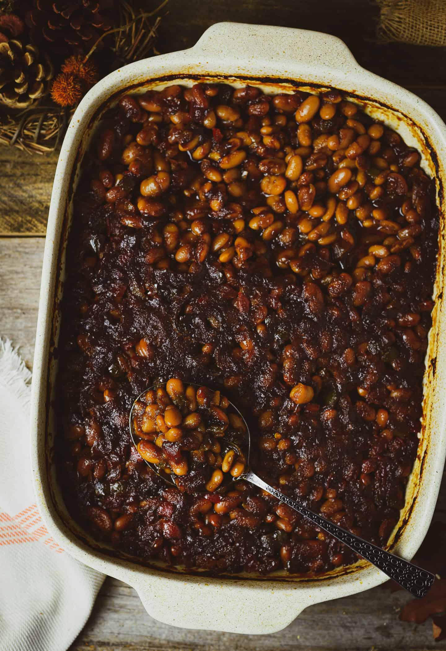 vegan baked beans in white baking dish.