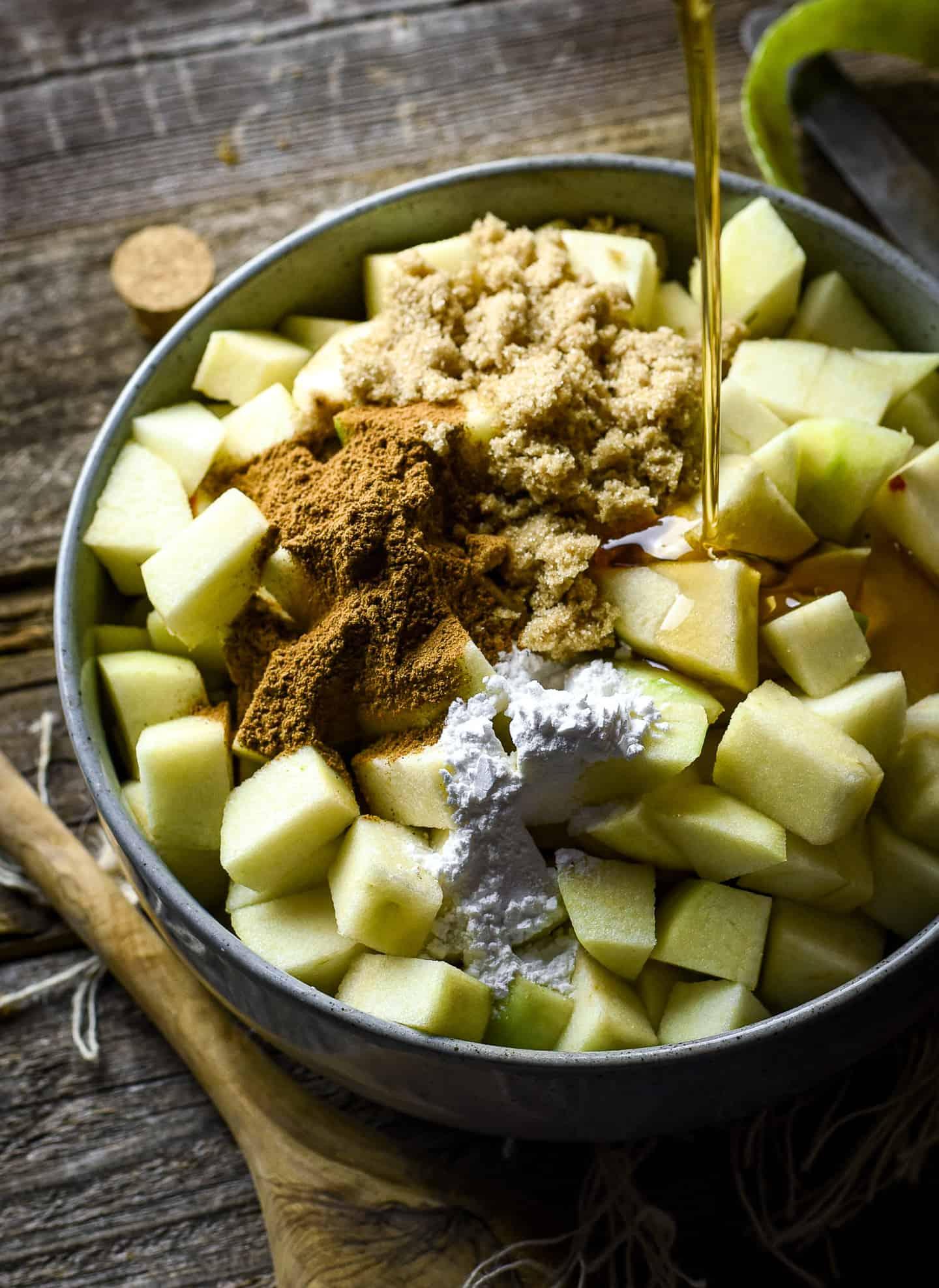 vegan apple crisp ingredients in a bowl.