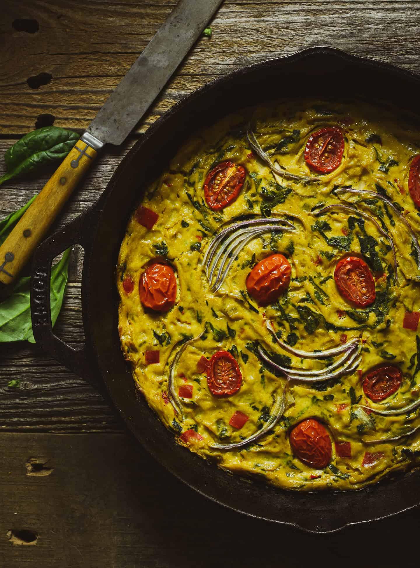 Vegetarian frittata in cast iron skillet.