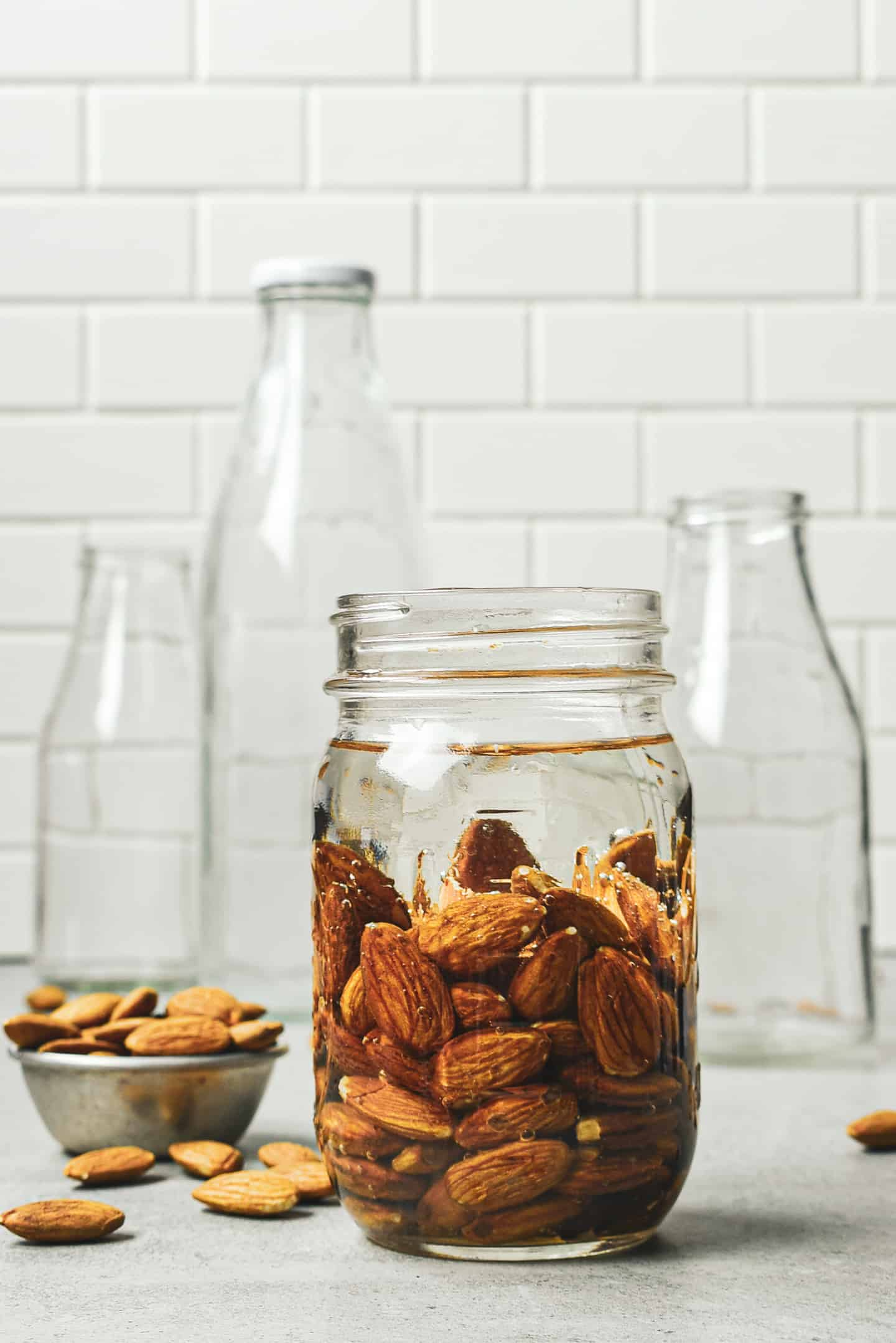 Almonds soaking in a jar of water.