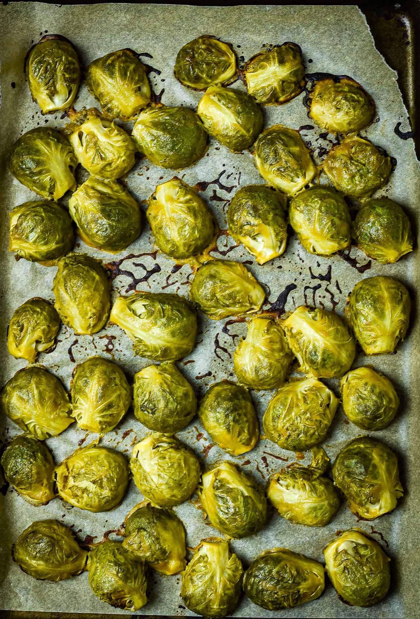 Roasted Brussels sprouts on baking sheet.