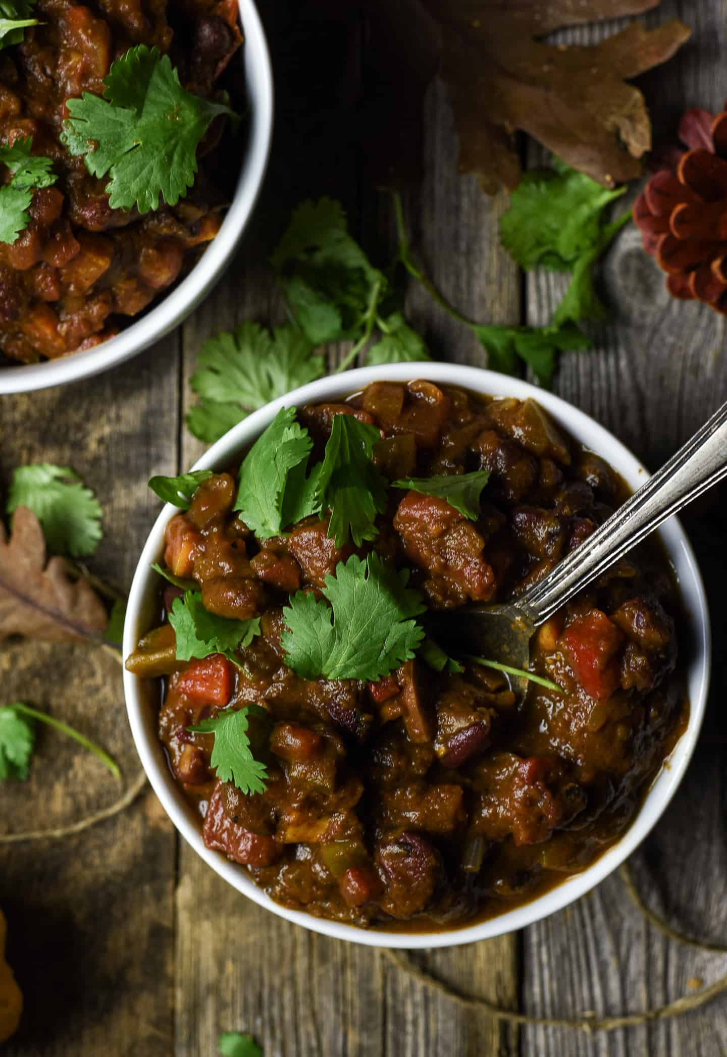 Bowl of chili with cilantro.