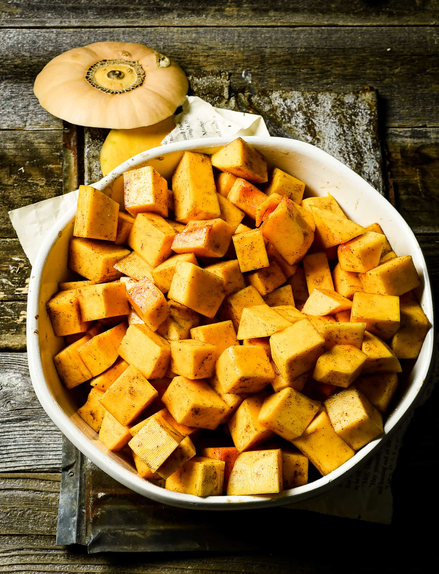 Butternut squash cubes in mixing bowl.