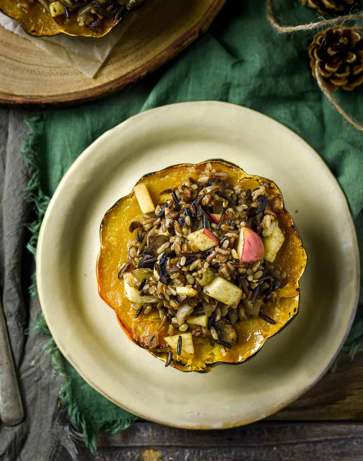 Stuffed acorn squash on plate.