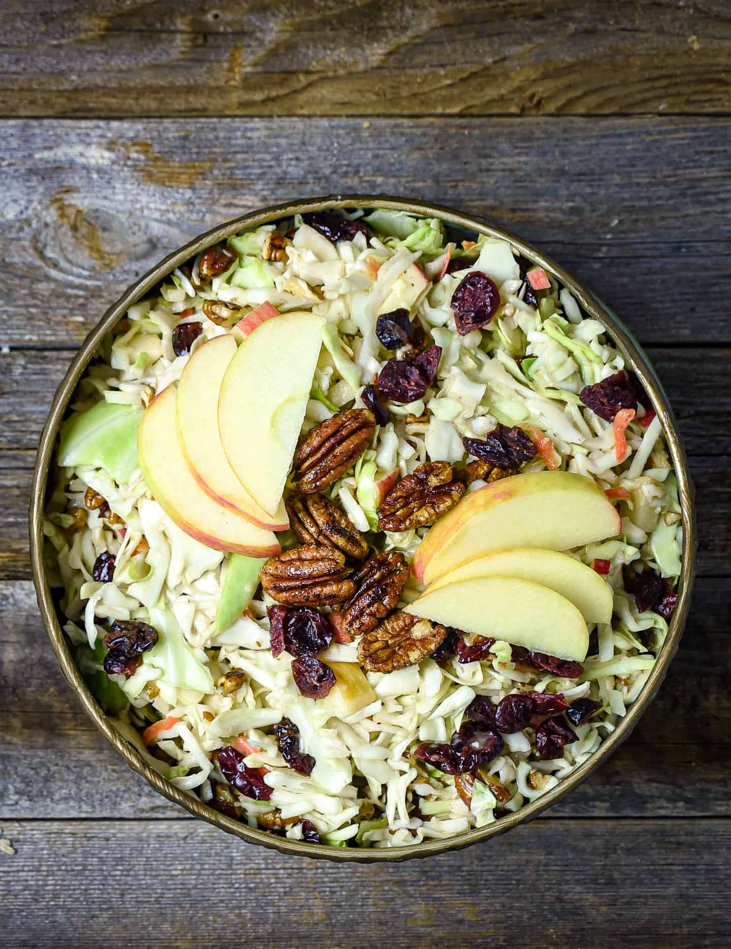 Cranberry coleslaw topped with apples and pecans.