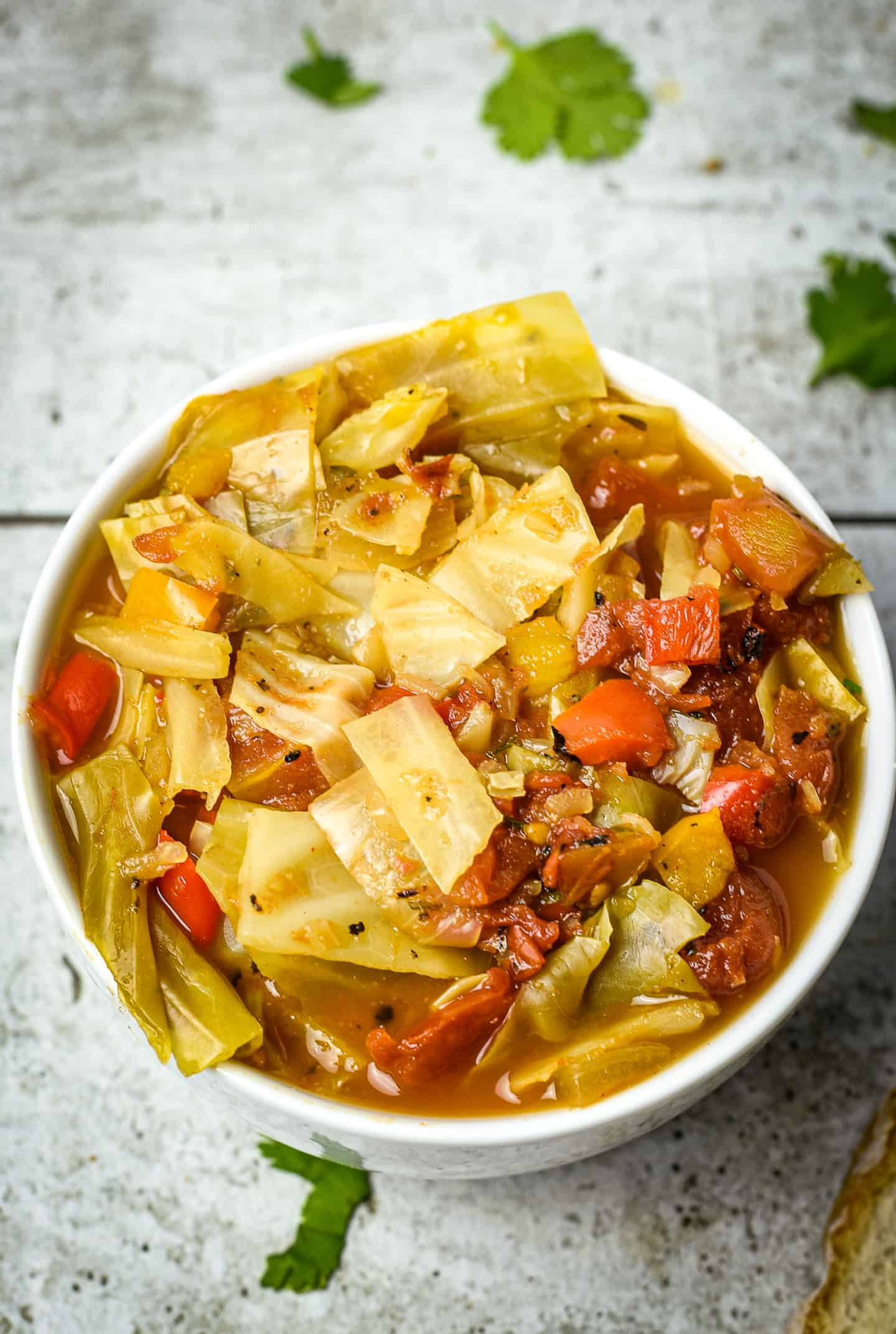 Vegetable soup with cabbage in bowl.