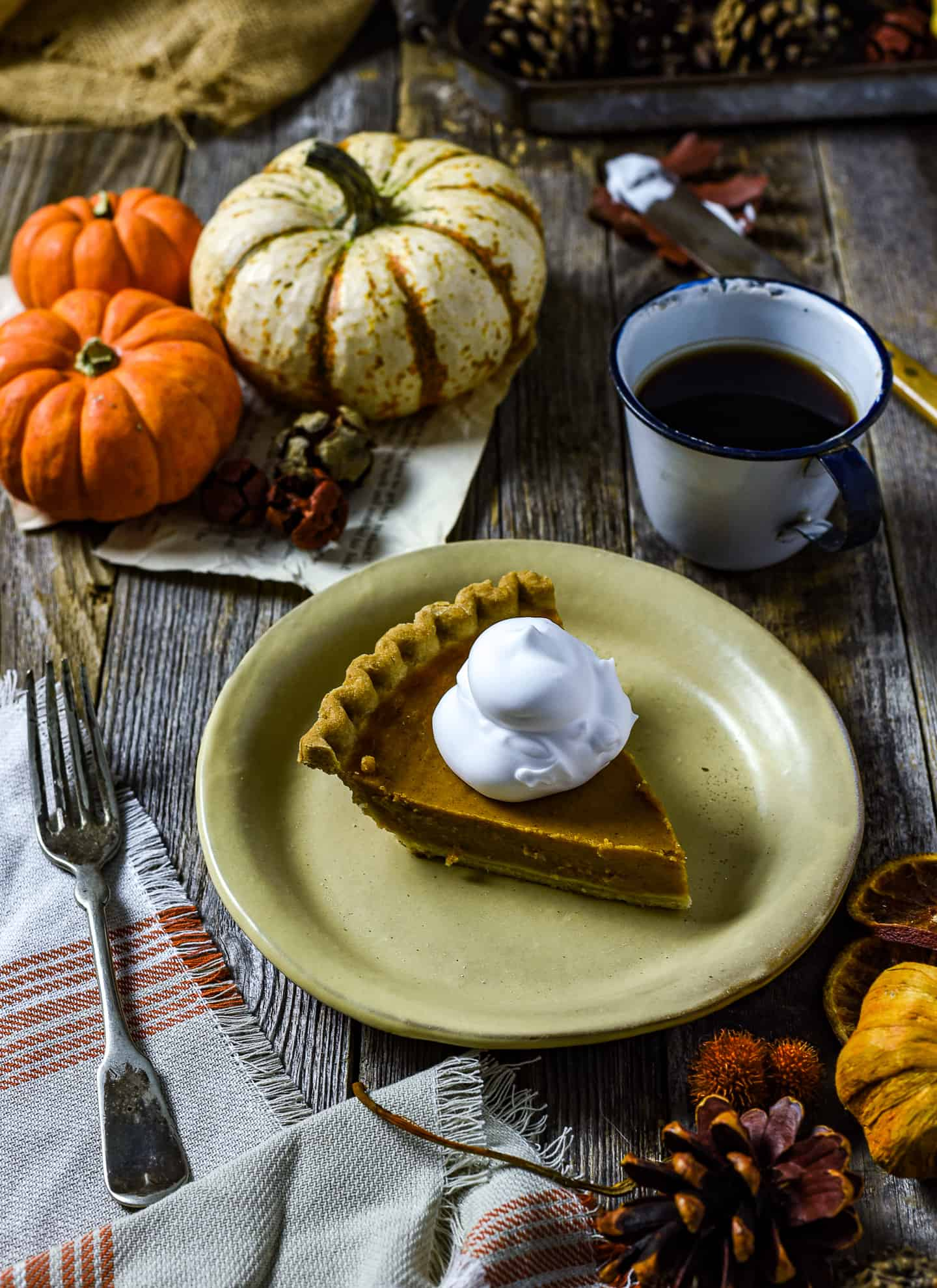 Whipped cream on top of pumpkin pie.
