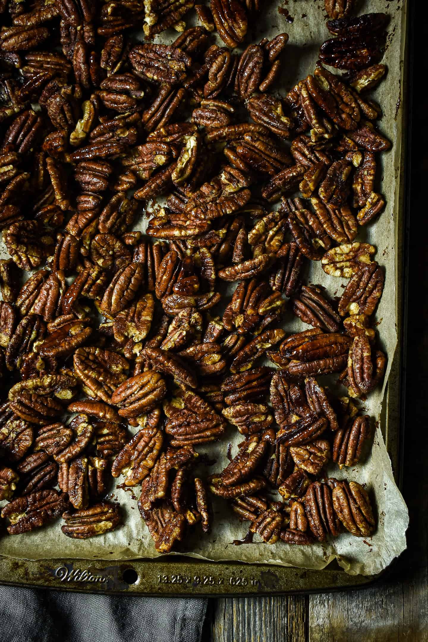 Candied pecans on baking sheet.