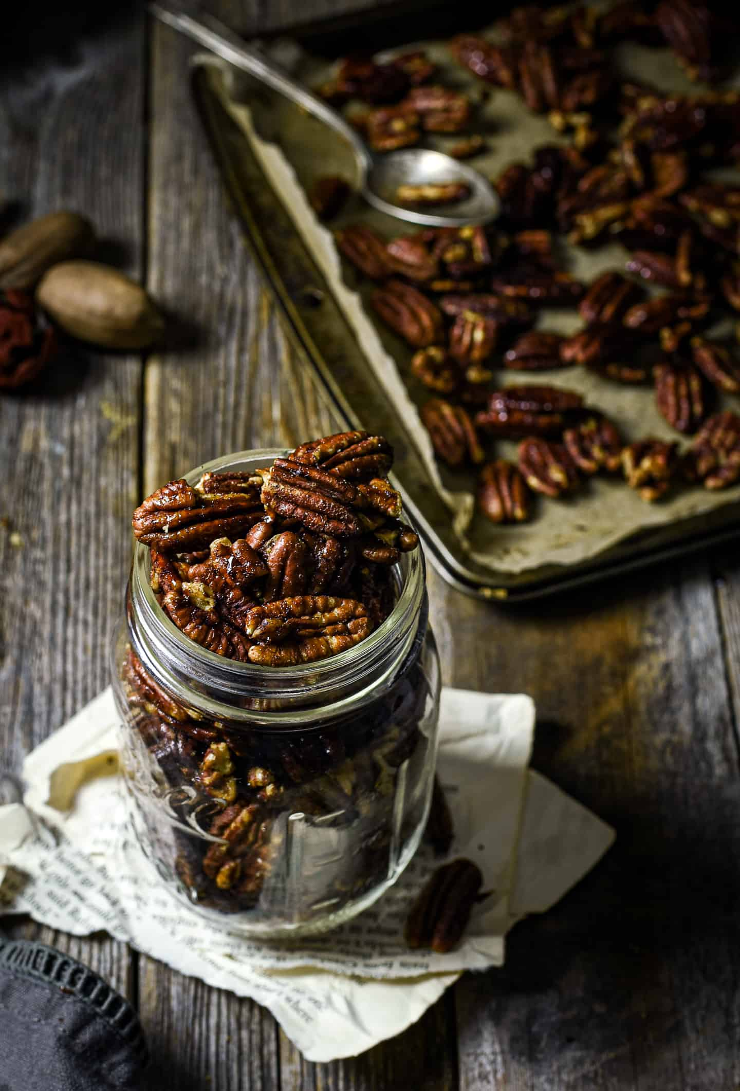 Maple roasted pecans in glass jar.