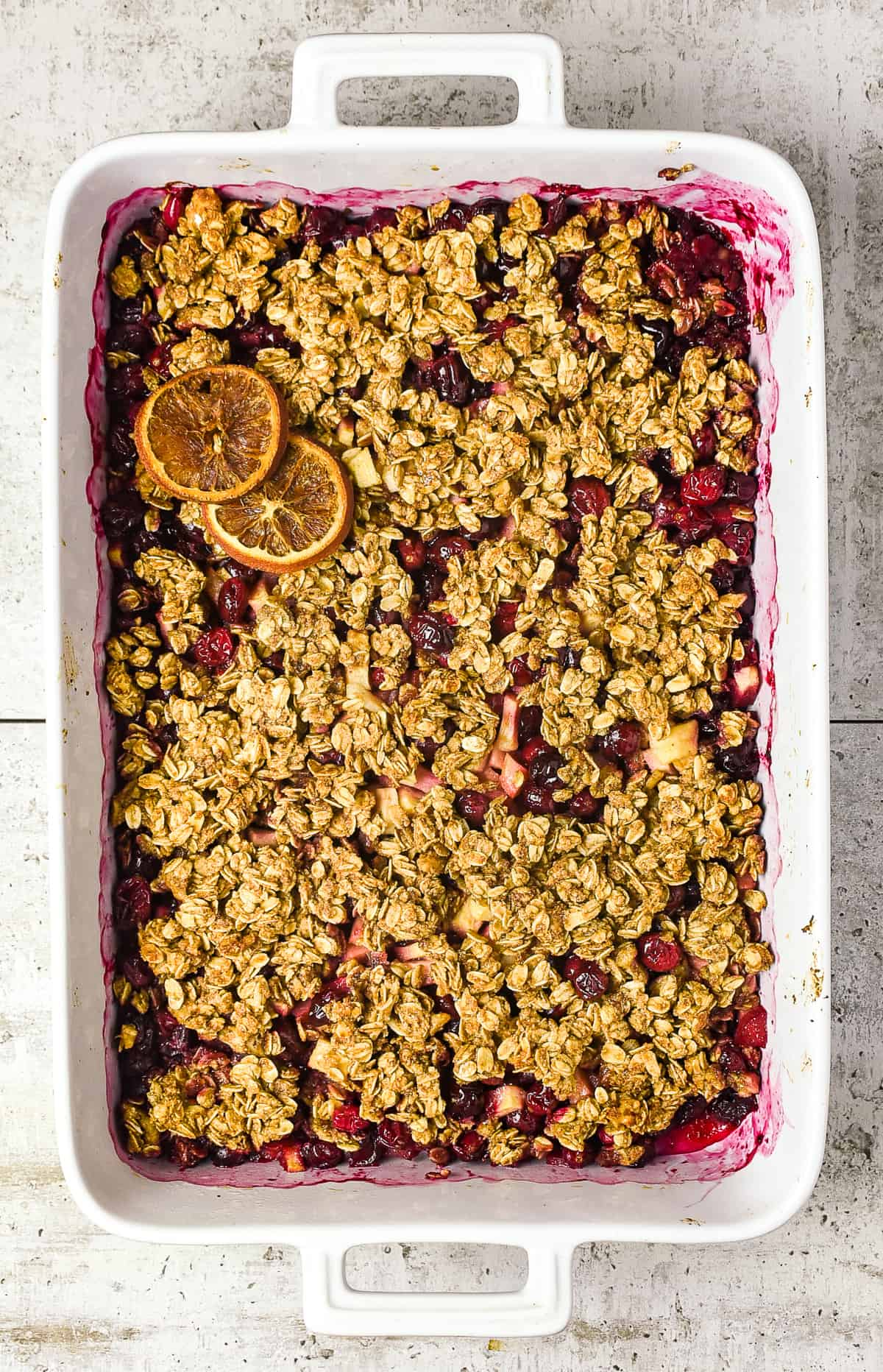 Baking dish of apple cranberry crisp.