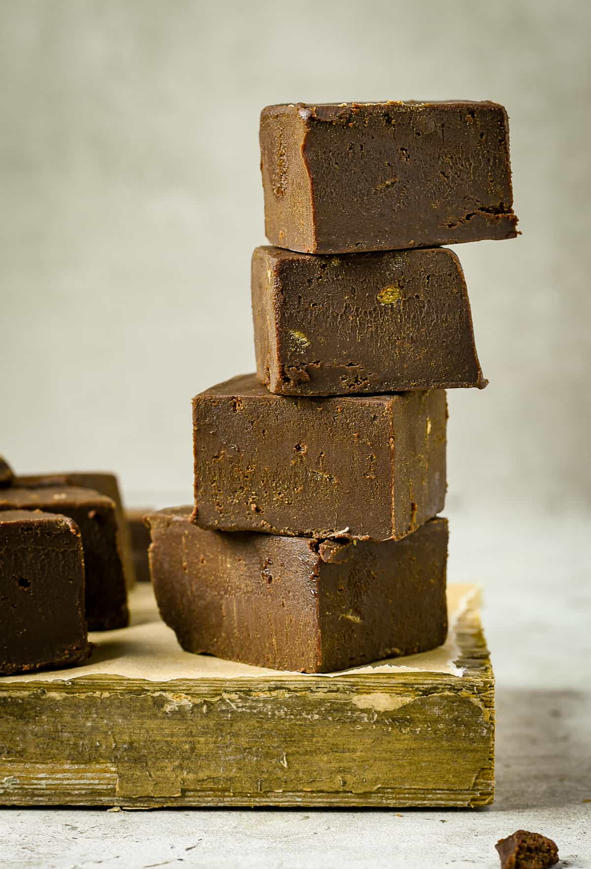 Four pieces of vegan fudge stacked.