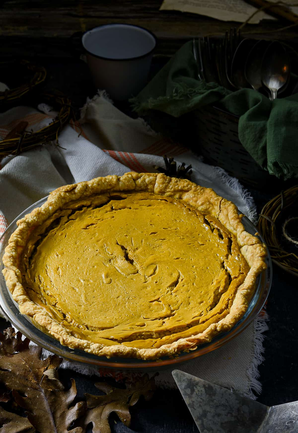 Vegan sweet potato pie in glass pie dish.