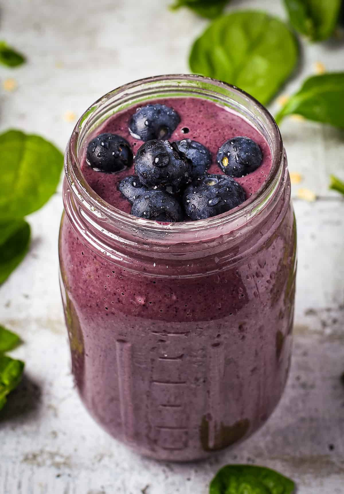 Berry smoothie with fresh blueberries on top.