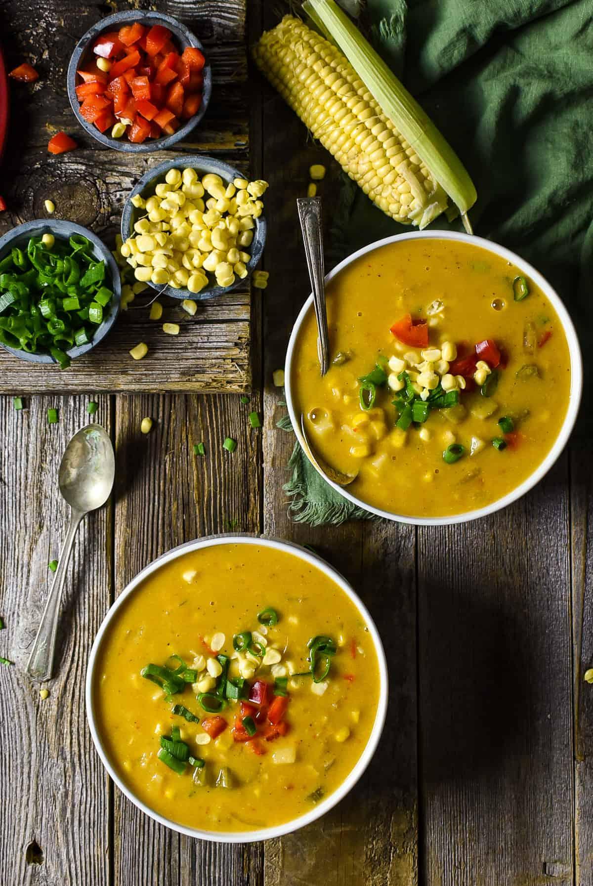 Two bowls of vegan corn chowder.