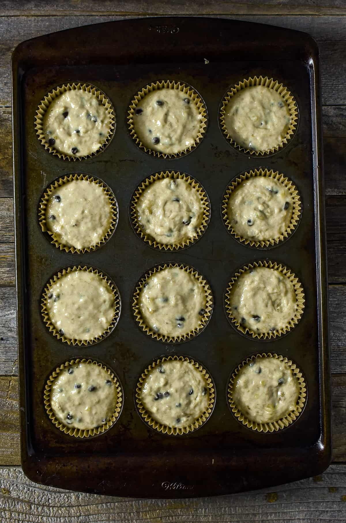 Pre-baked muffin batter in muffin pan.