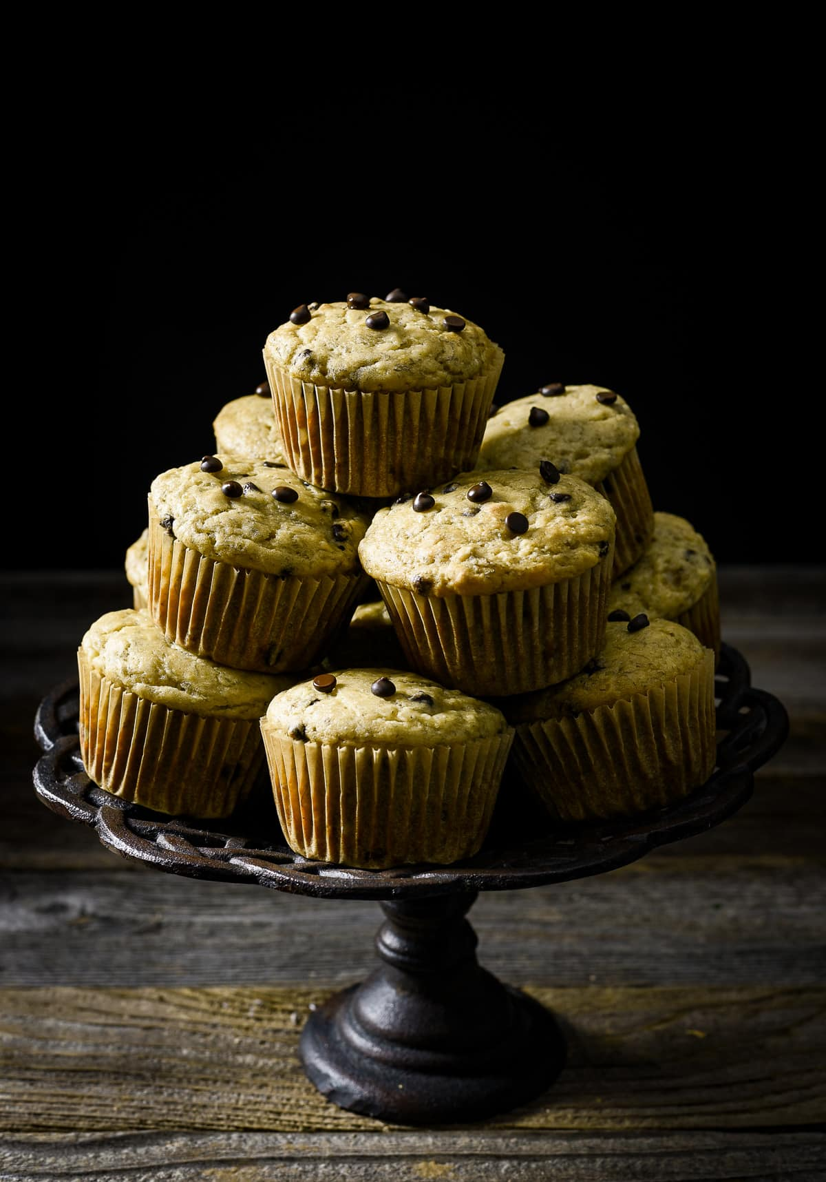 Healthy banana muffins stacked on cake stand.