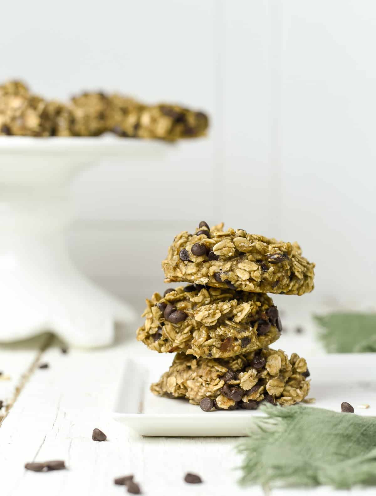 Chocolate chip oatmeal cookies stacked.