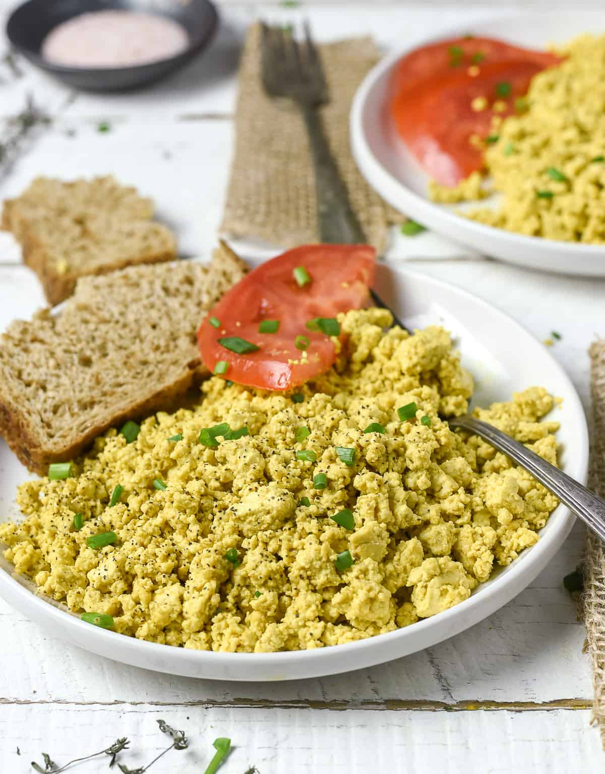 Tofu scramble on plate with fork.