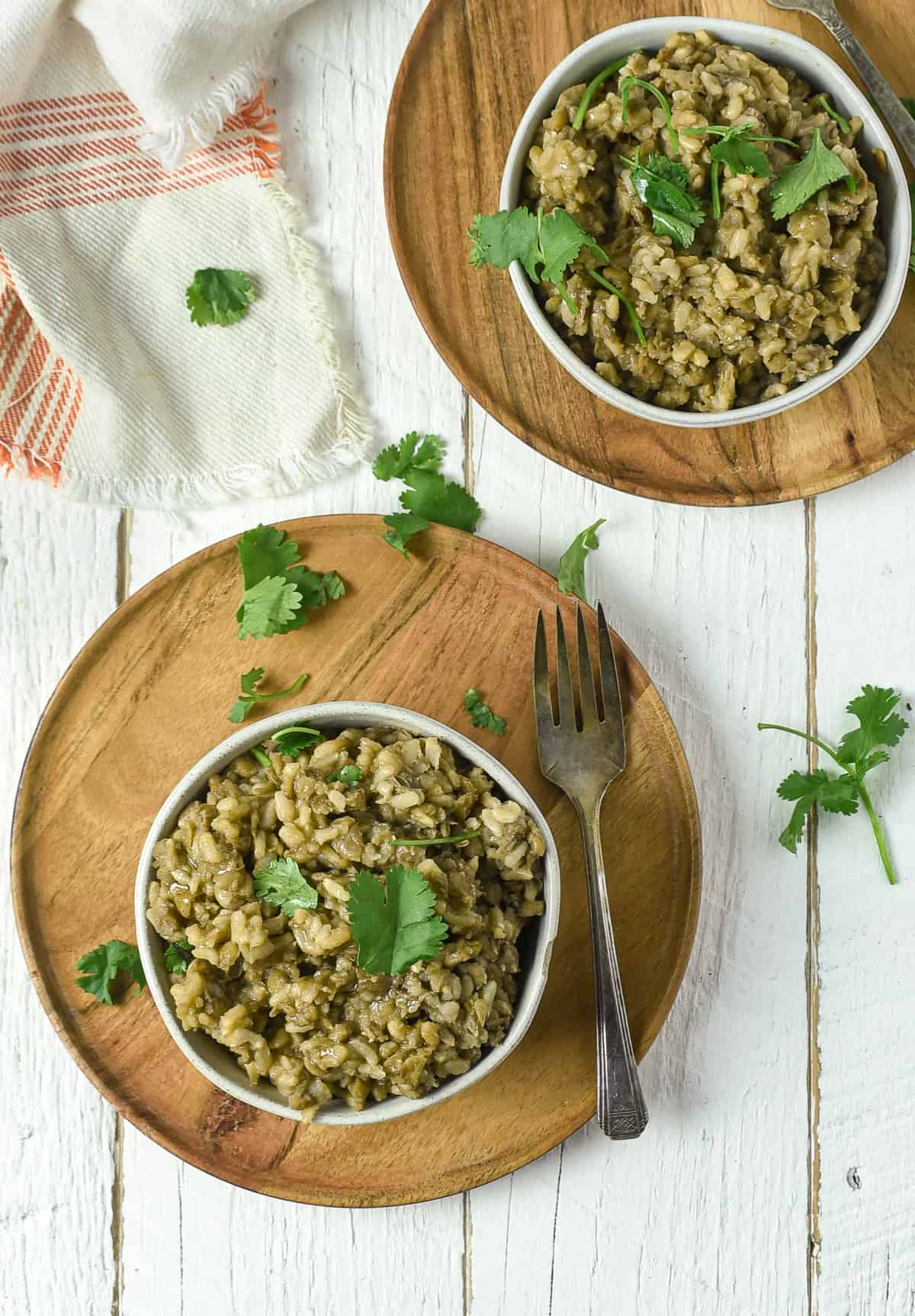 brown rice and lentils in white bowls.