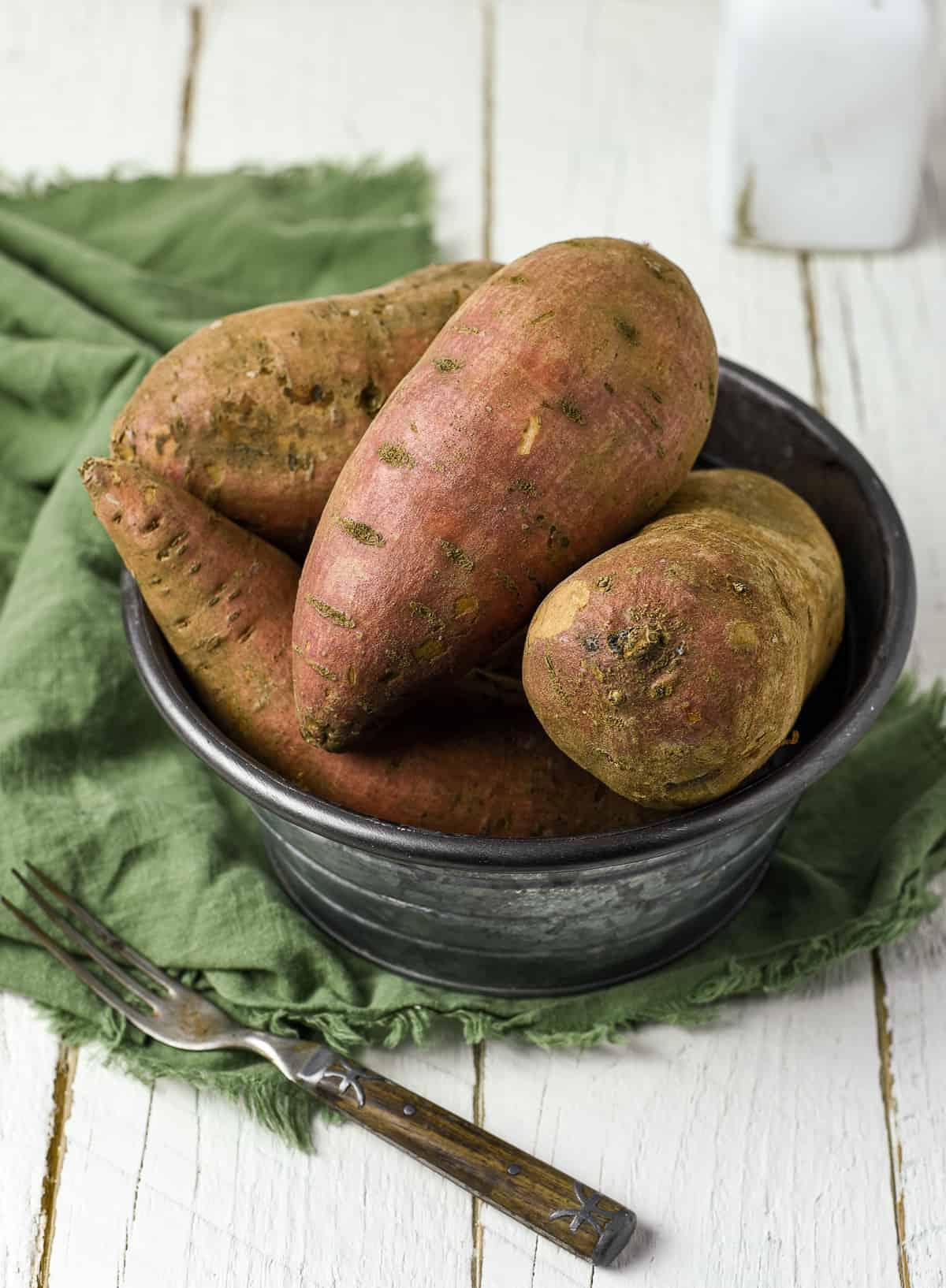 Bucket of sweet potatoes.