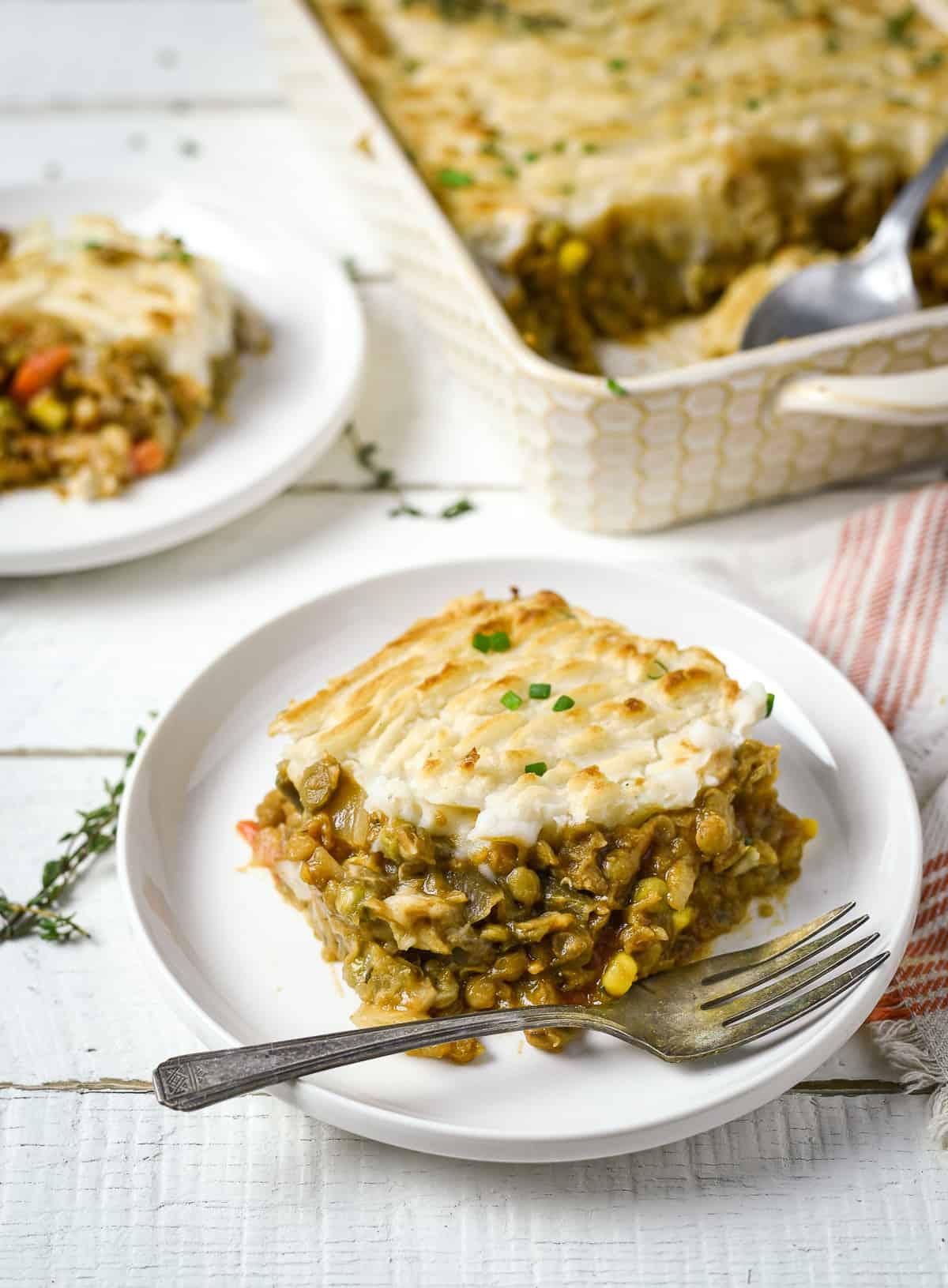 Vegan lentil shepherd's pie on plate with fork.