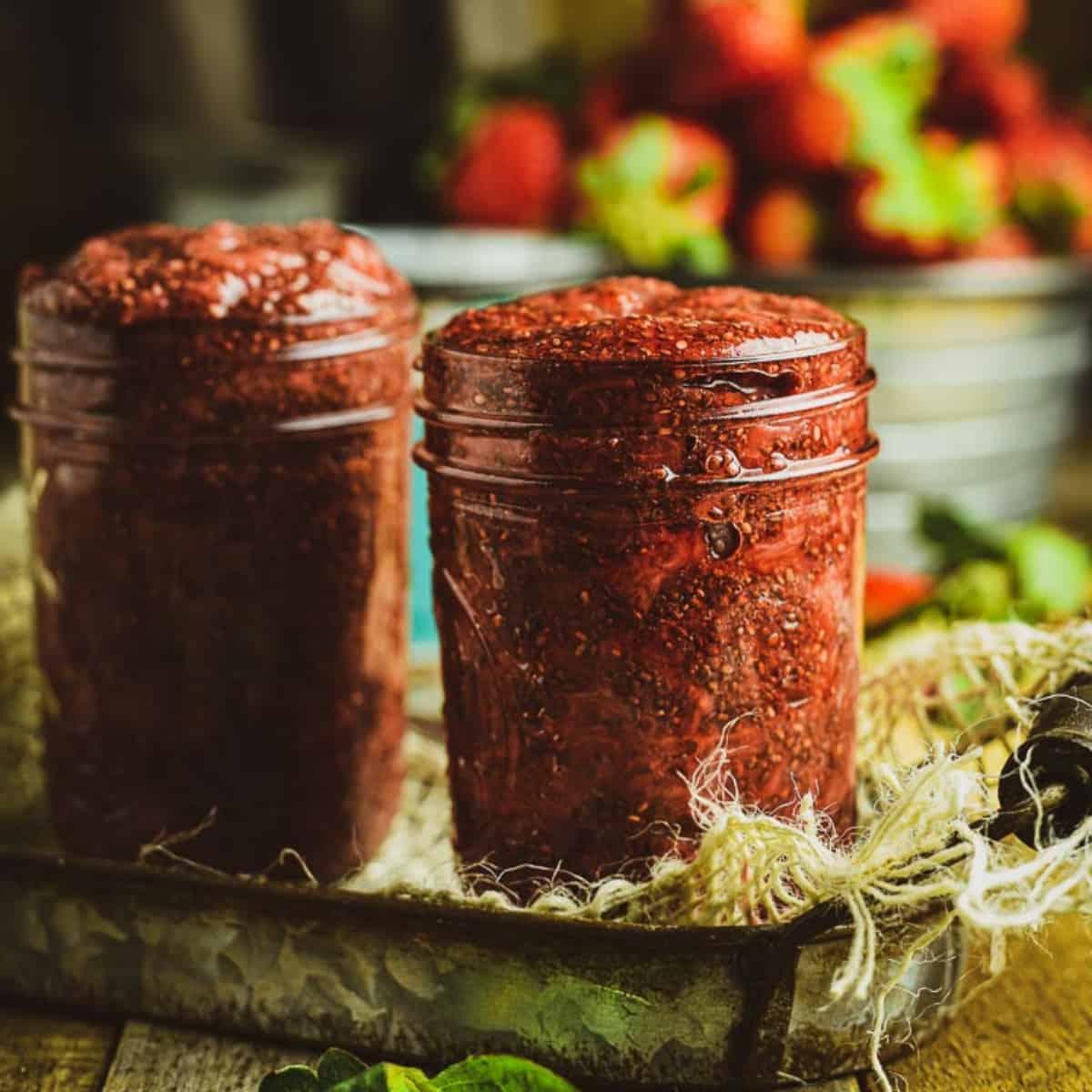 Strawberry chia jam in glass jar.
