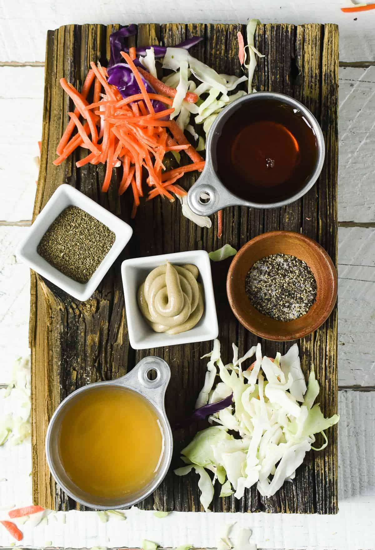 Slaw ingredients on cutting board.