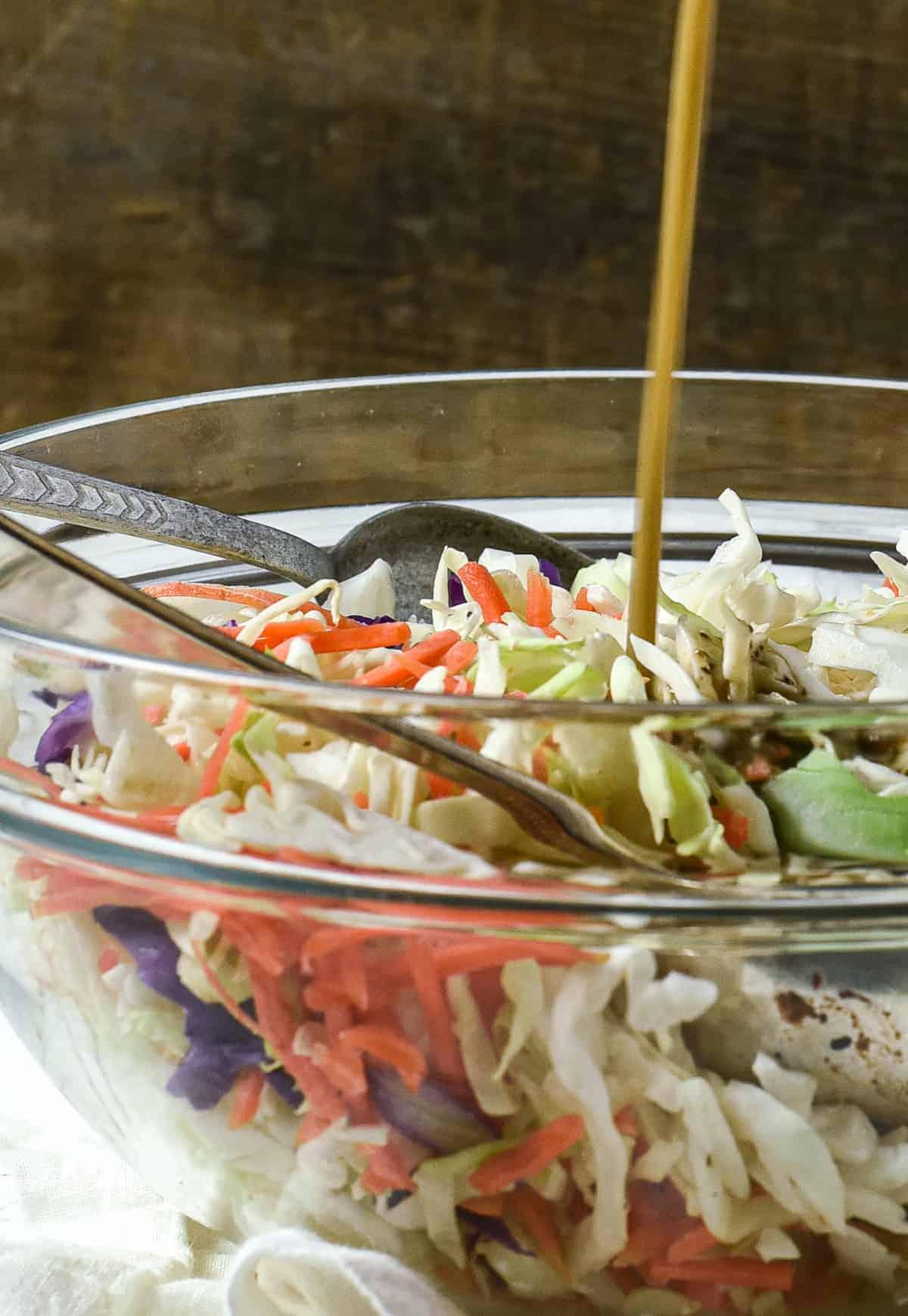 Dressing poured onto salad.