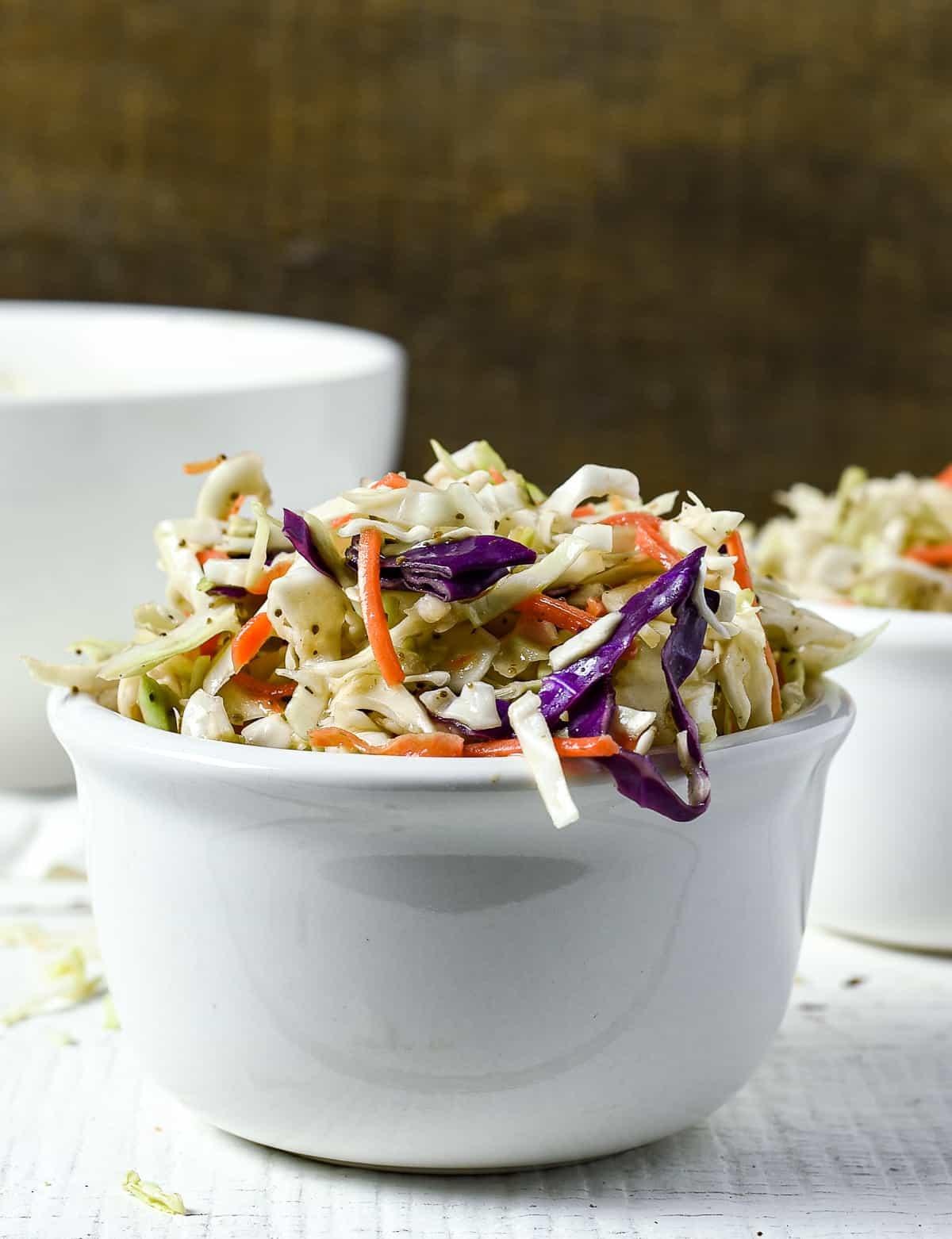 Coleslaw in white bowl.