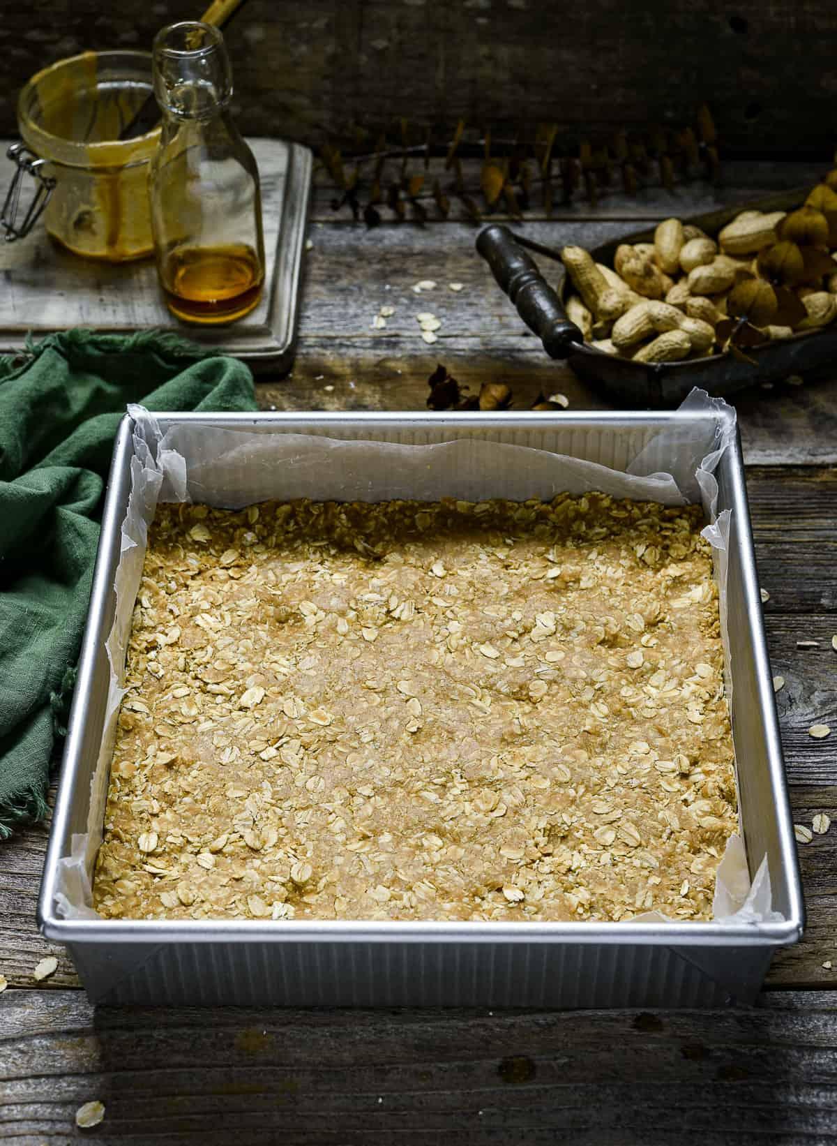 Peanut butter oatmeal mixture in baking pan.