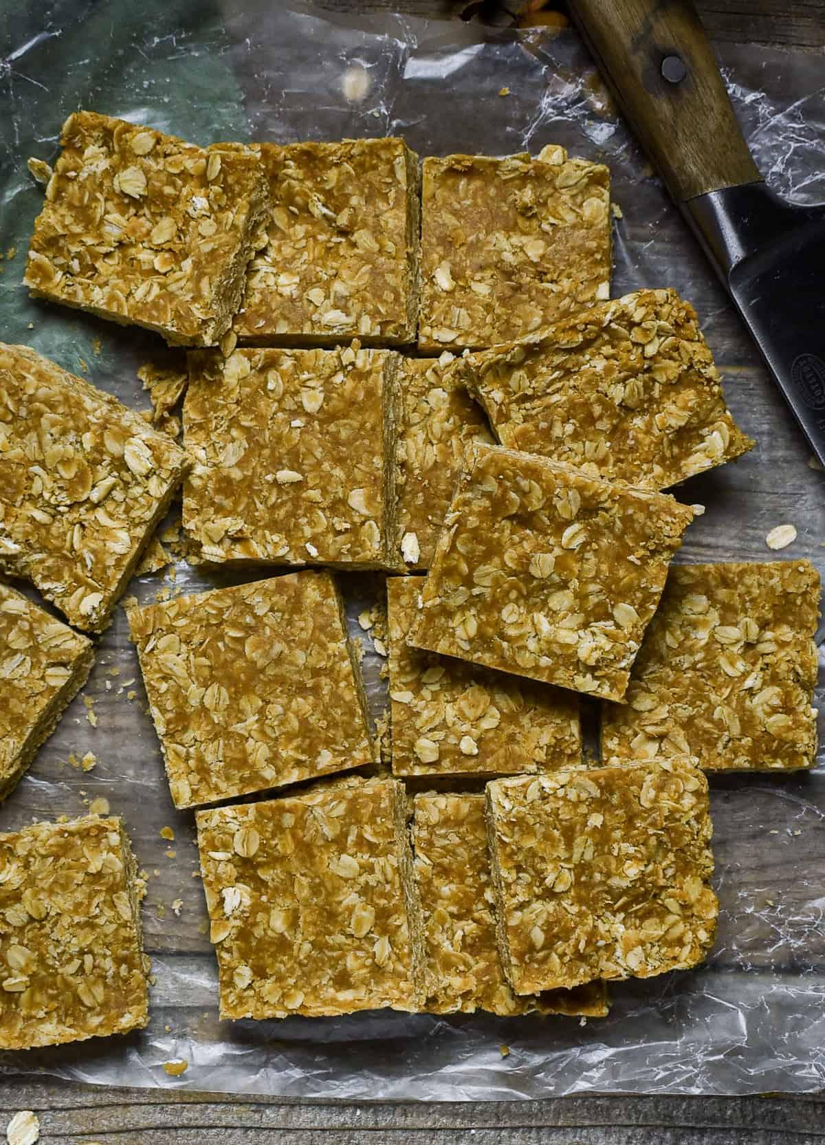 Peanut butter oatmeal bars on wax paper.