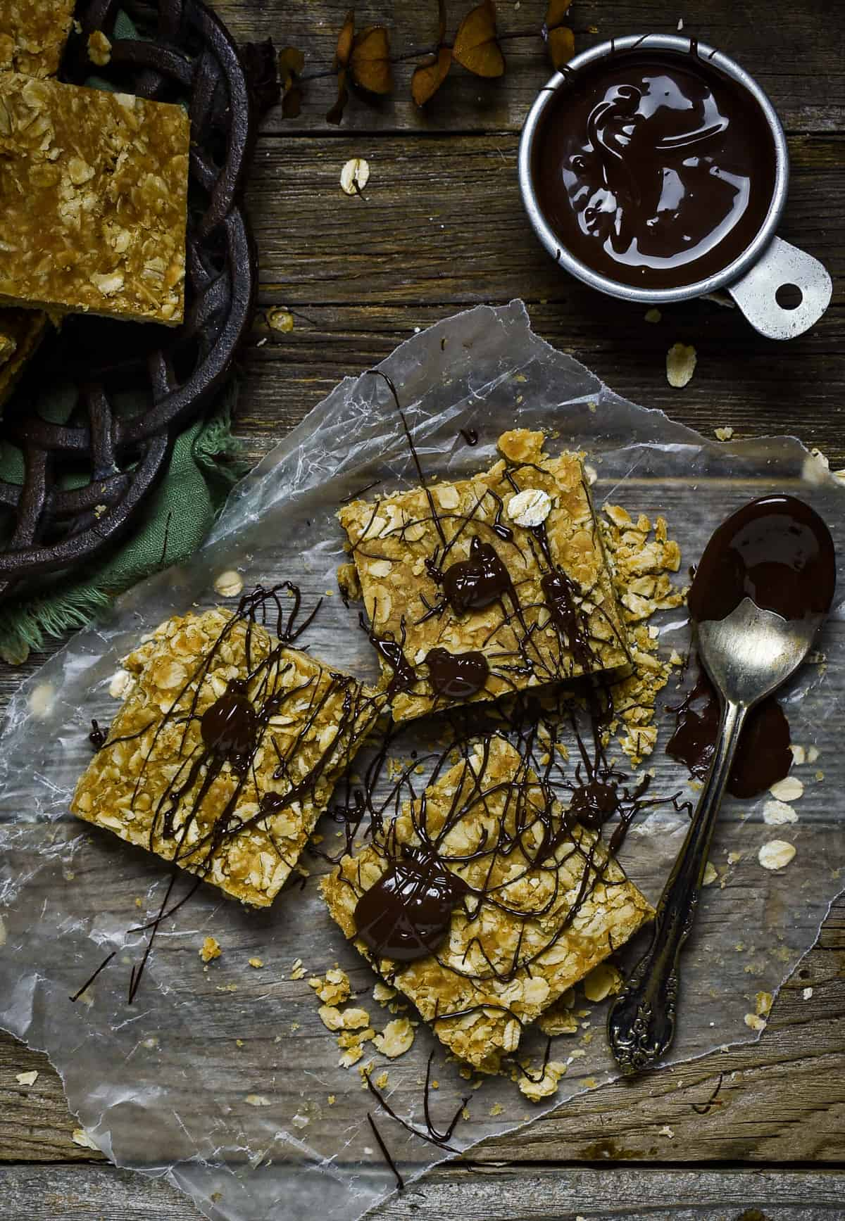 Peanut butter oatmeal bars drizzled with chocolate.