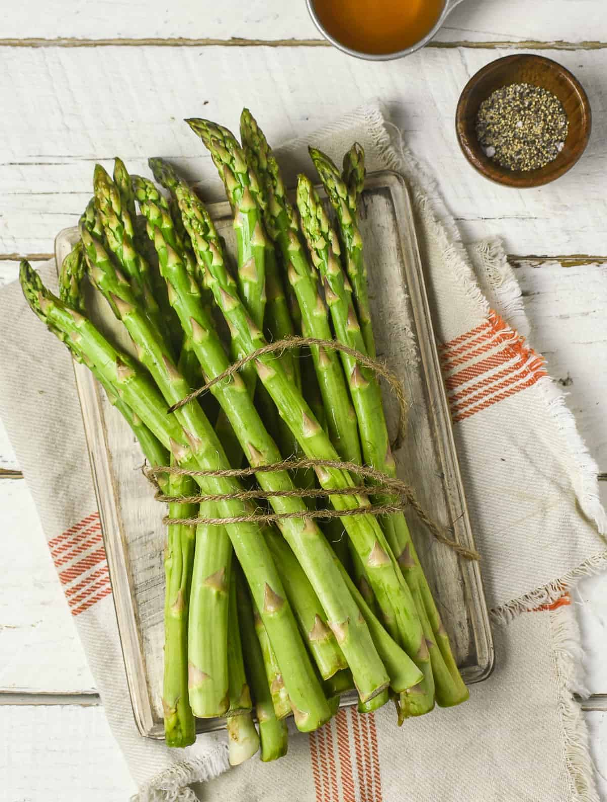 Raw asparagus in twine.