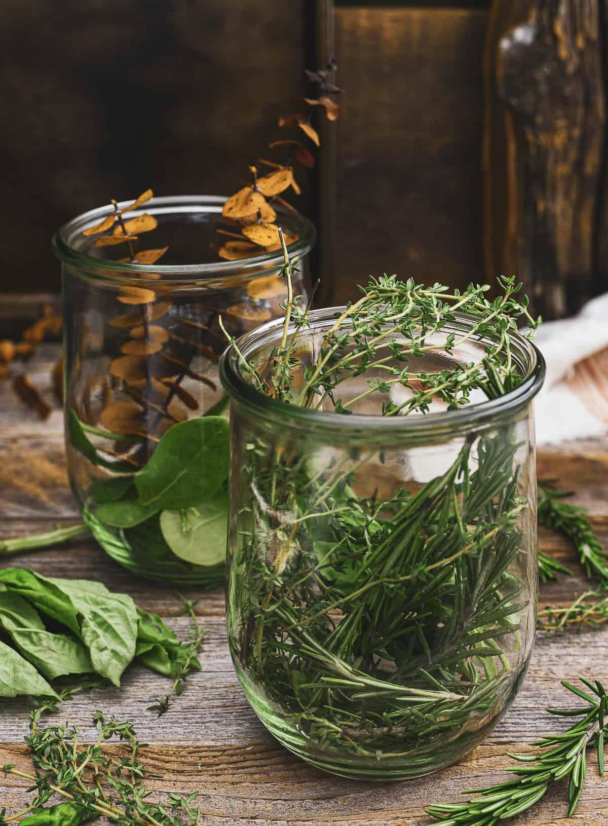 Herbs in glass jars.