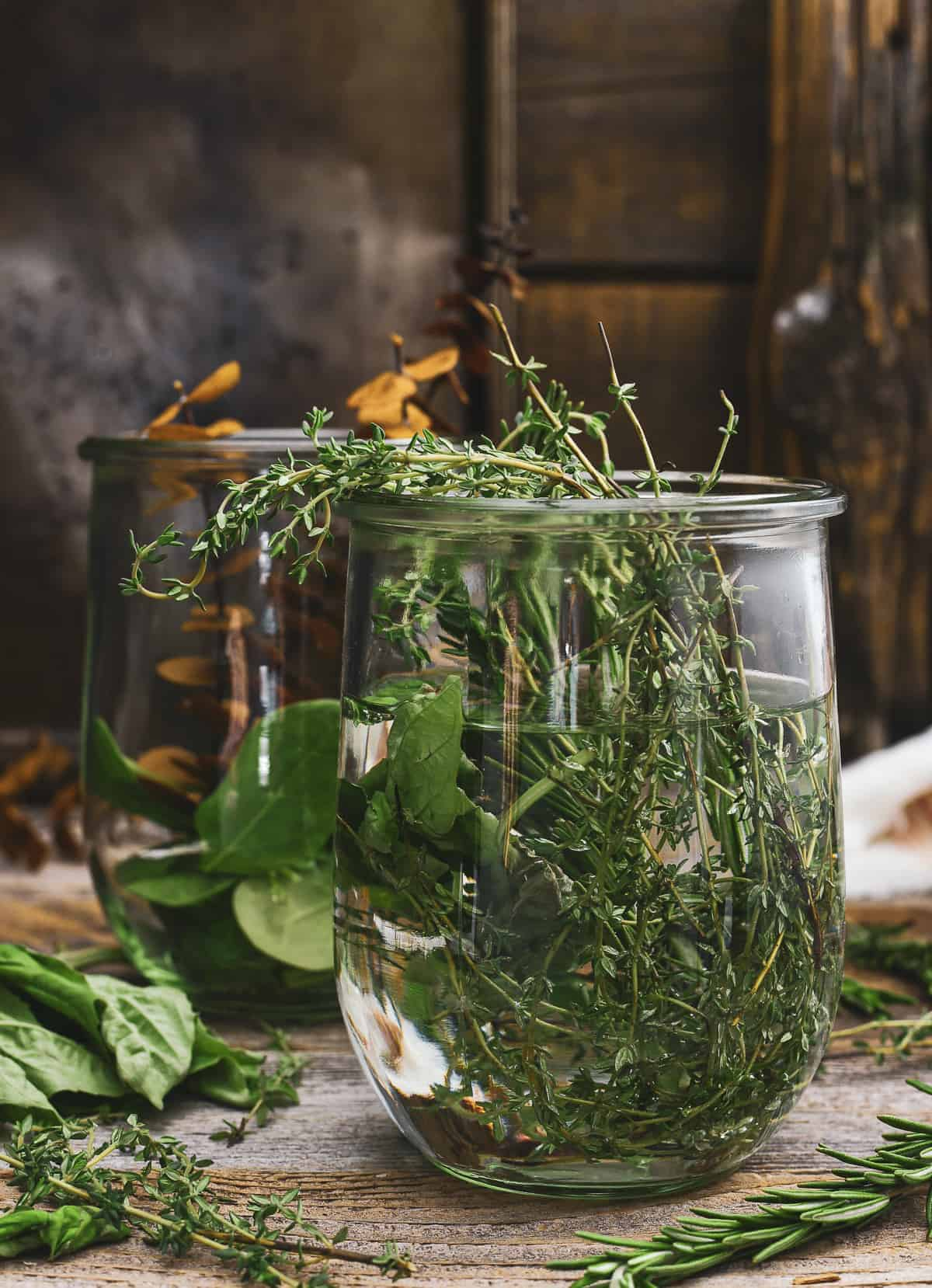 Herbs and water in glass jars.