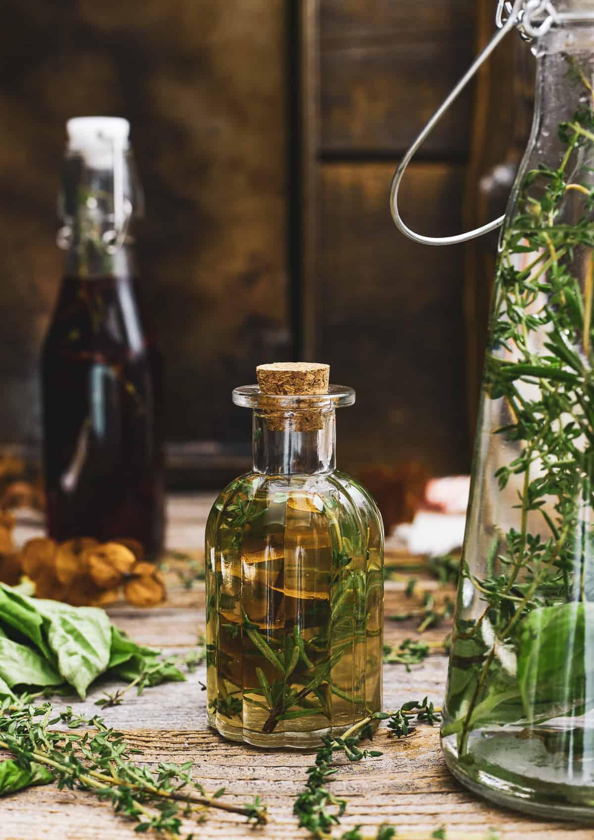 Small bottle of herbal infused vinegar.