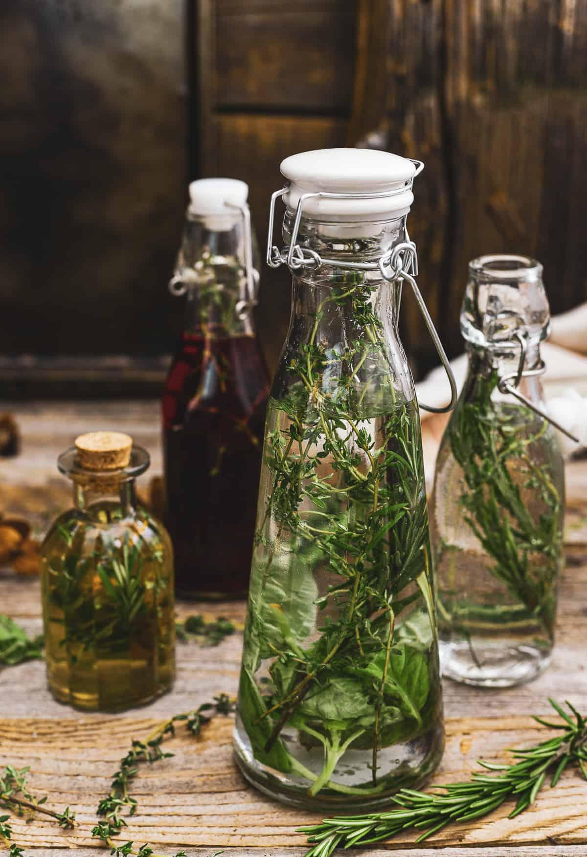 Four bottles of herb vinegar.